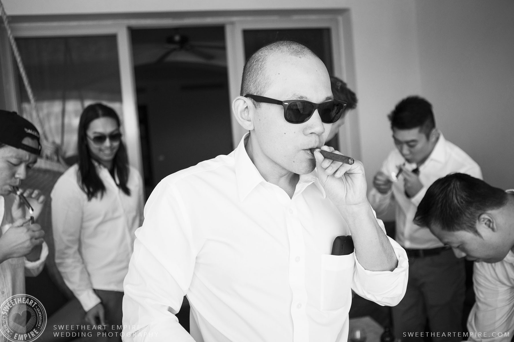 Groomsman smoking a cigar; Iberostar Grand Hotel Rose Hall, in Montego Bay, Jamaica