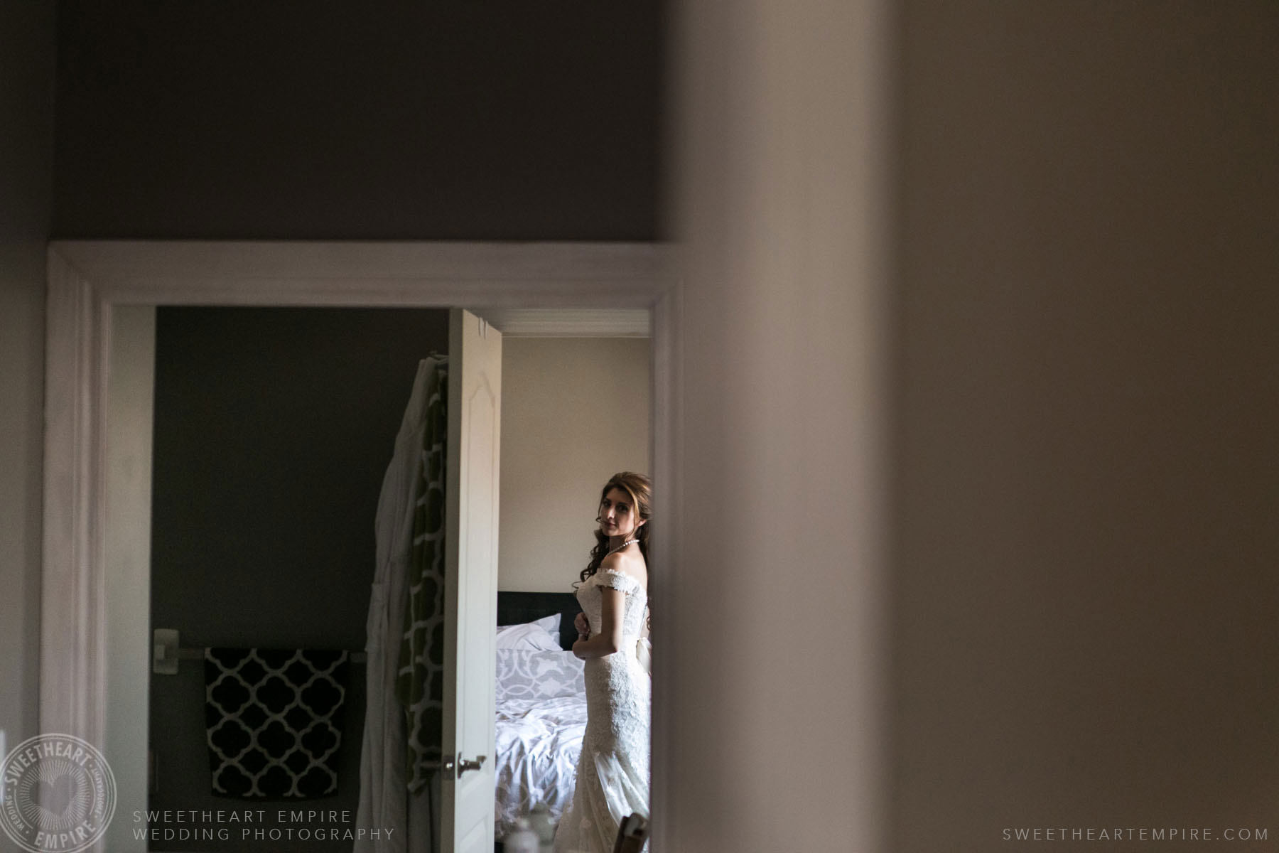 Bride looking at herself in the mirror; Eagles Nest Golf Club Wedding Photos