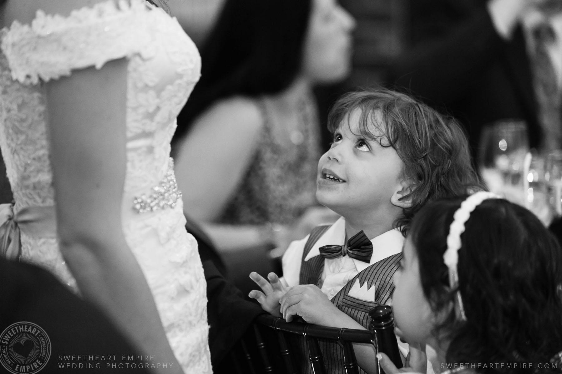 Little boy looking at bride; Eagles Nest Golf Club Wedding