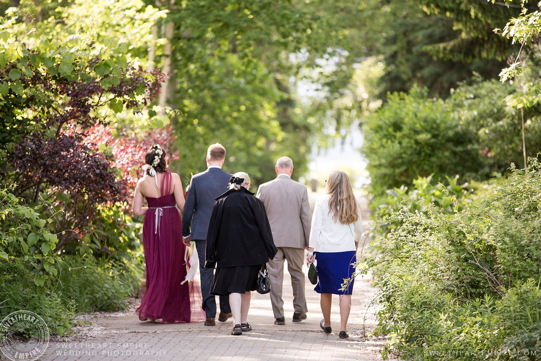 Walking to the ceremony, Toronto Island Elopement