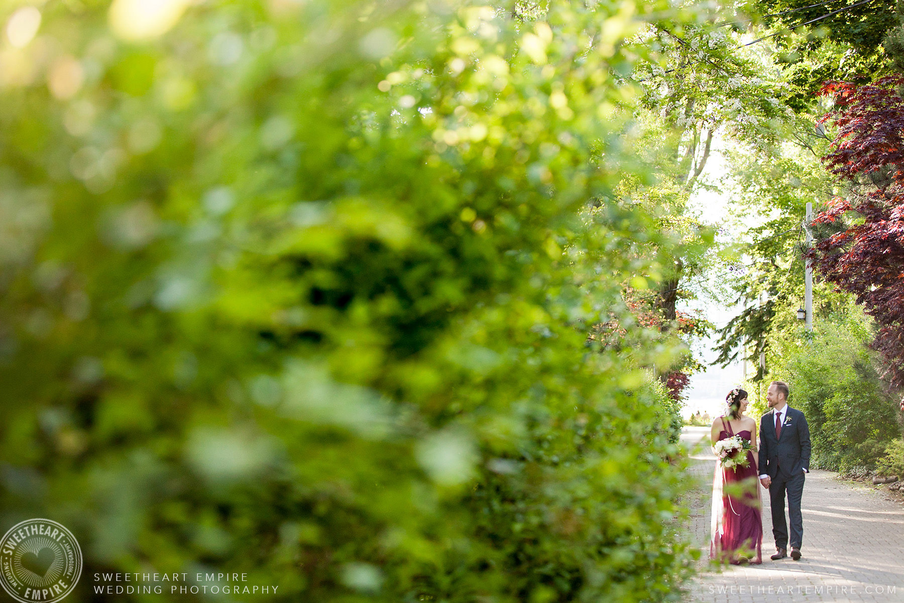 Bride and groom walking together, Toronto Island Elopement