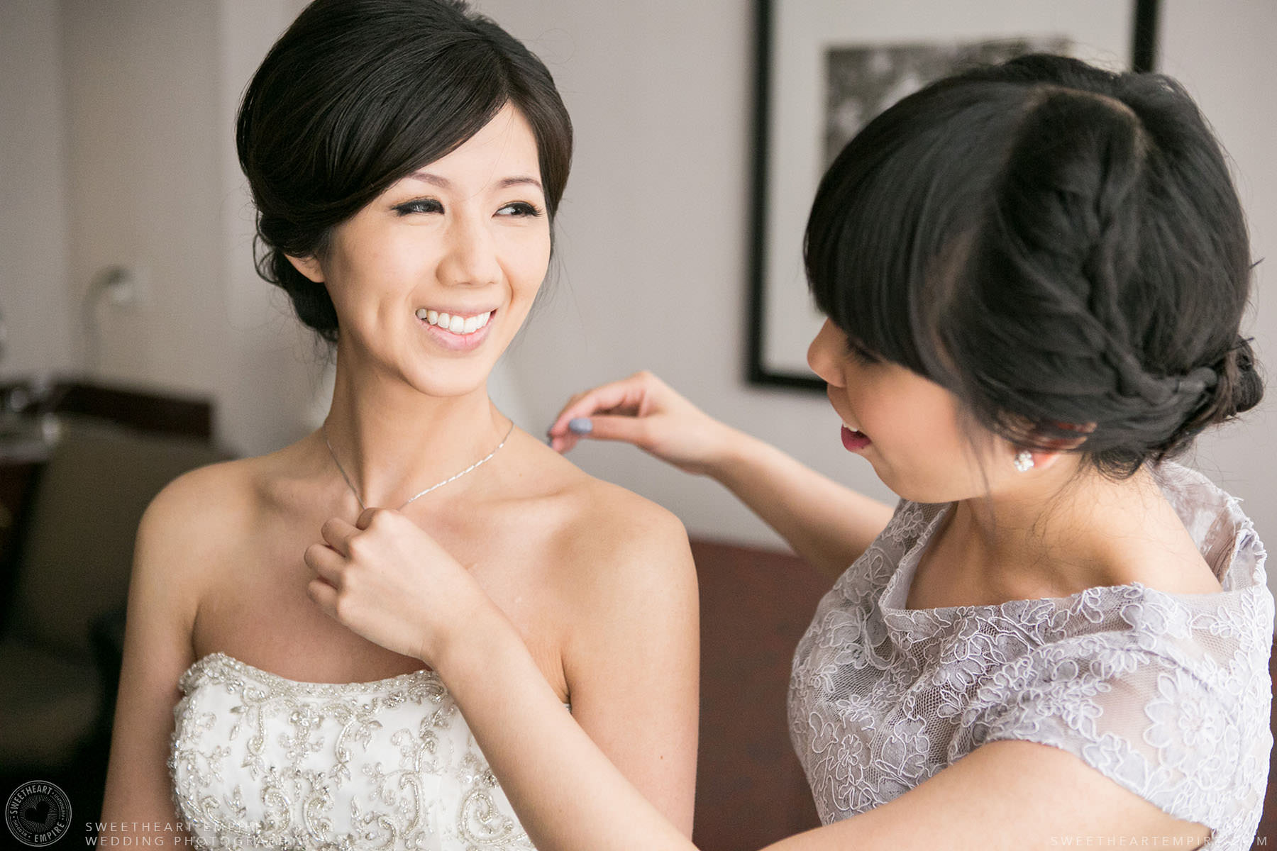 Bride putting on her necklace, Hart House University of Toronto Wedding