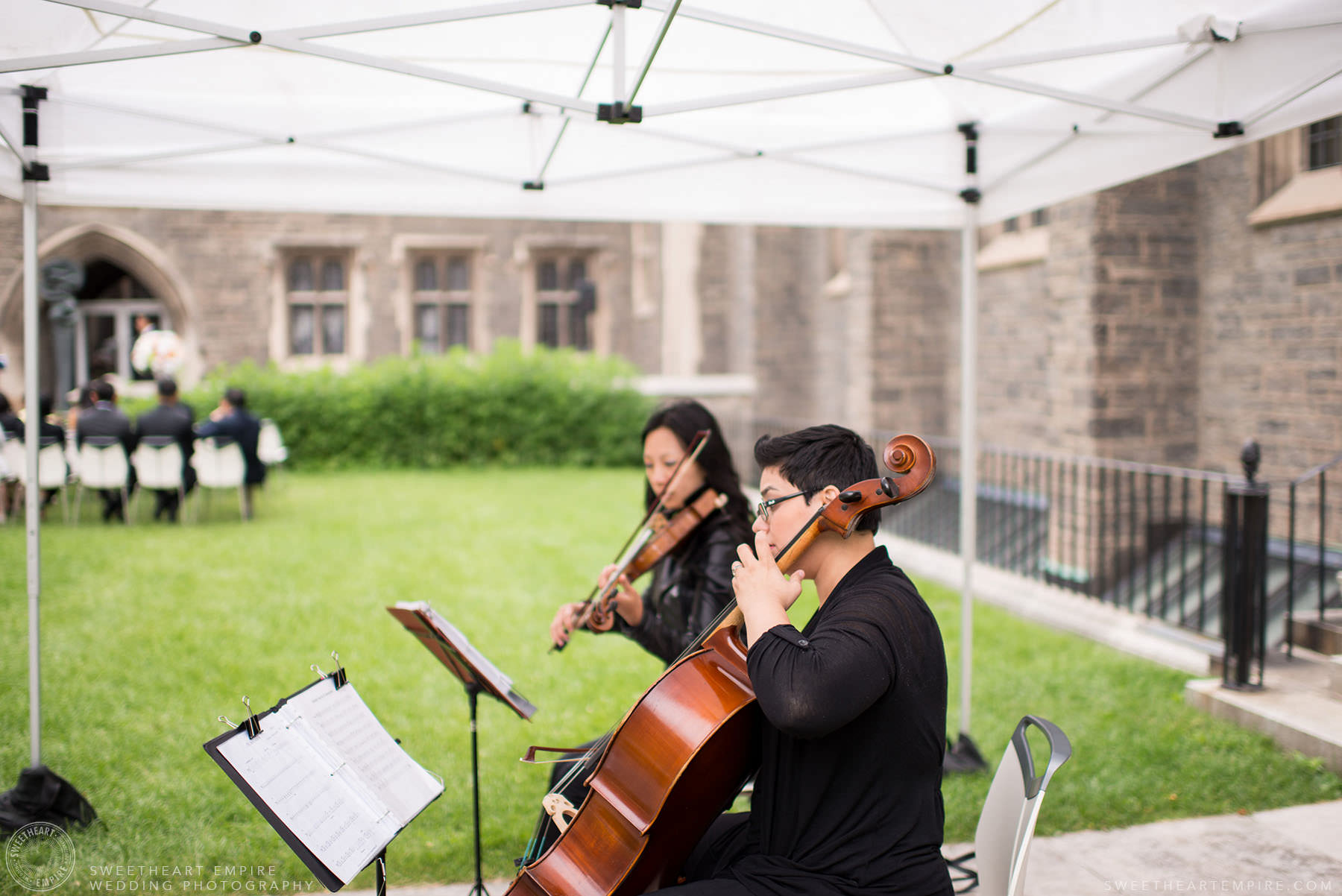 Musicians playing music during ceremony, Hart House University of Toronto Wedding