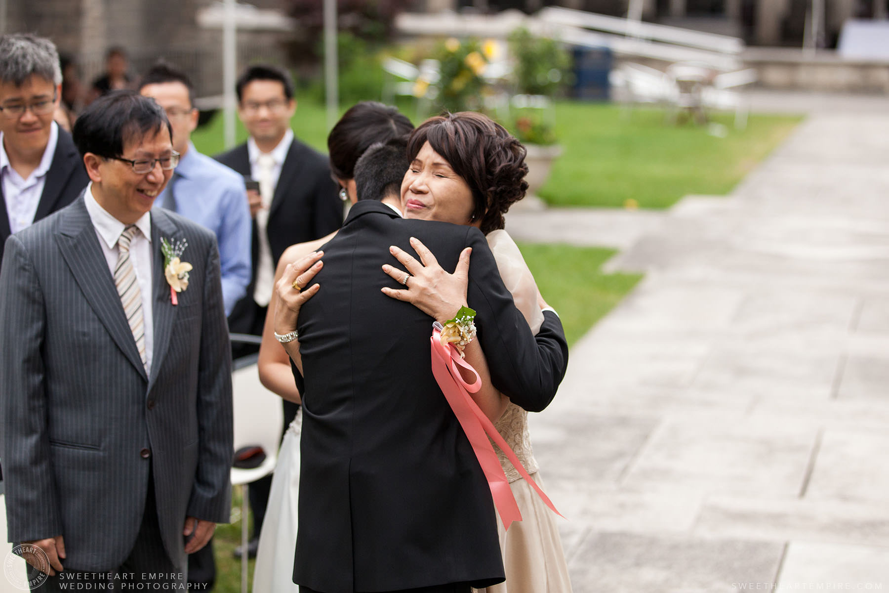 Groom hugging his mother before ceremony, Hart House University of Toronto Wedding