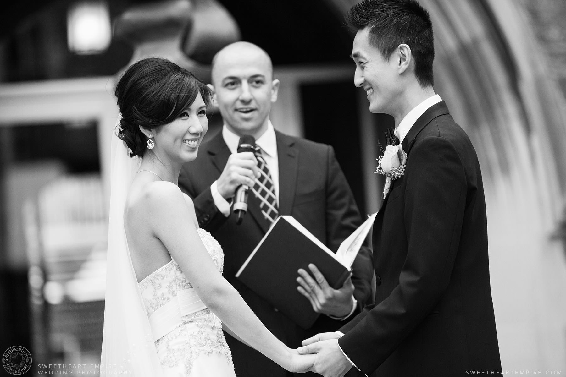 Bride and groom exchanging vows, Hart House University of Toronto Wedding