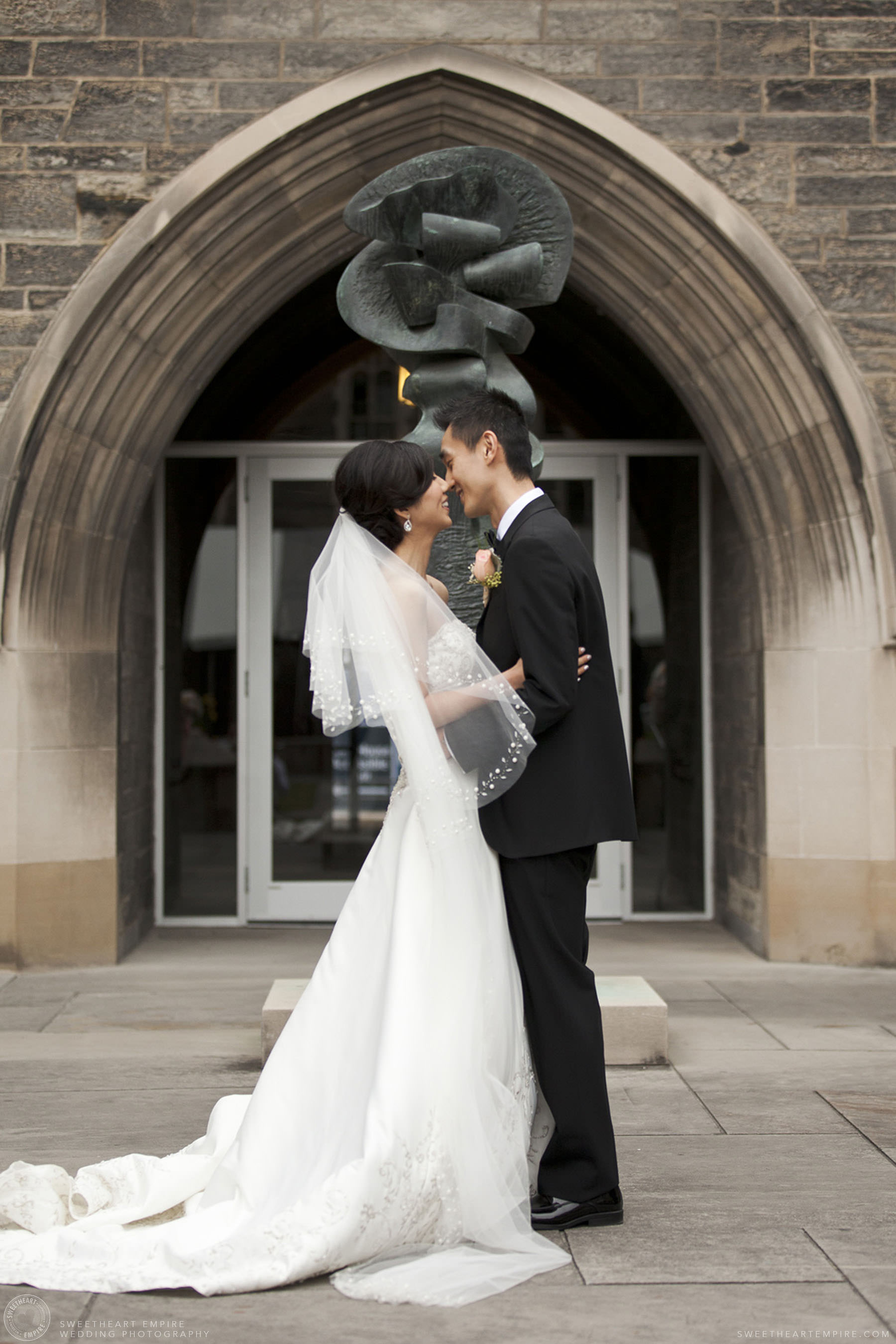 Bride and groom getting ready for a kiss after marriage ceremony, Hart House University of Toronto Wedding