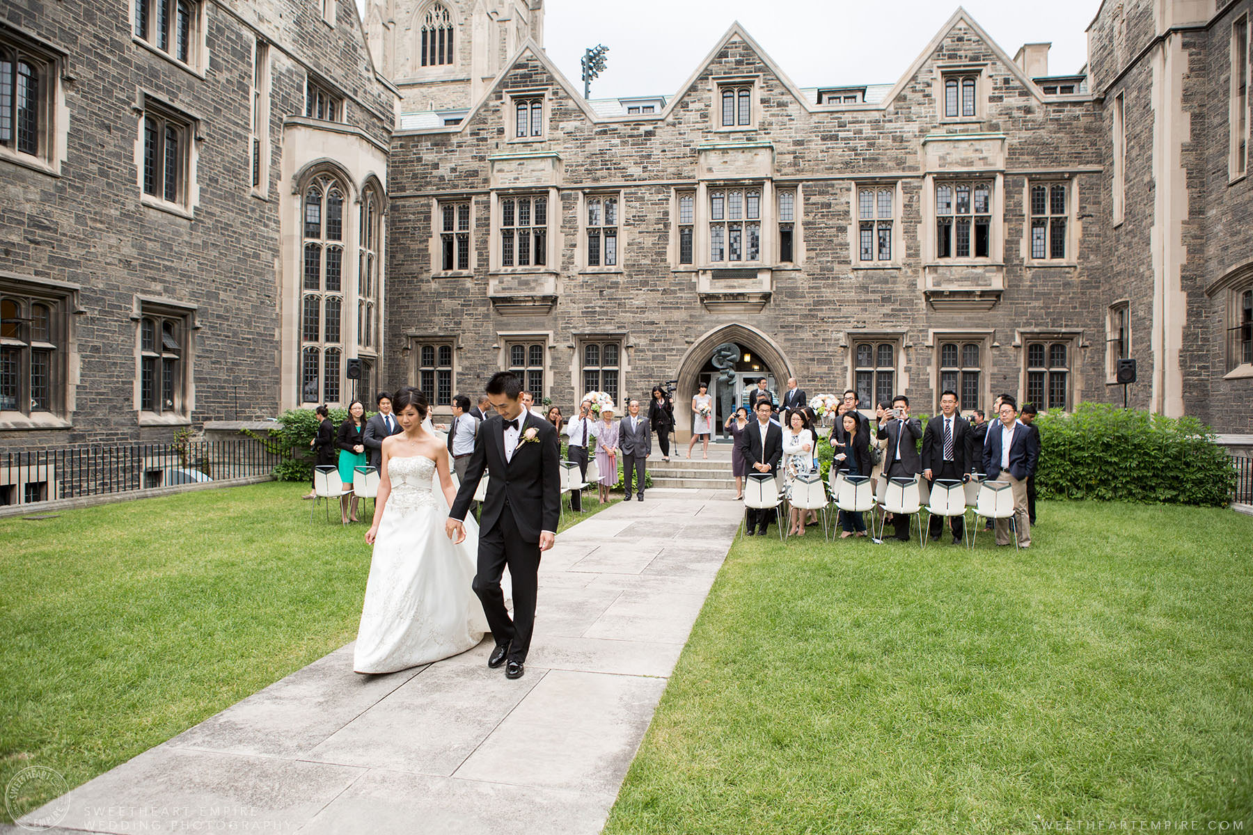 Bride and groom walking down the aisle after being married, Hart House University of Toronto Wedding