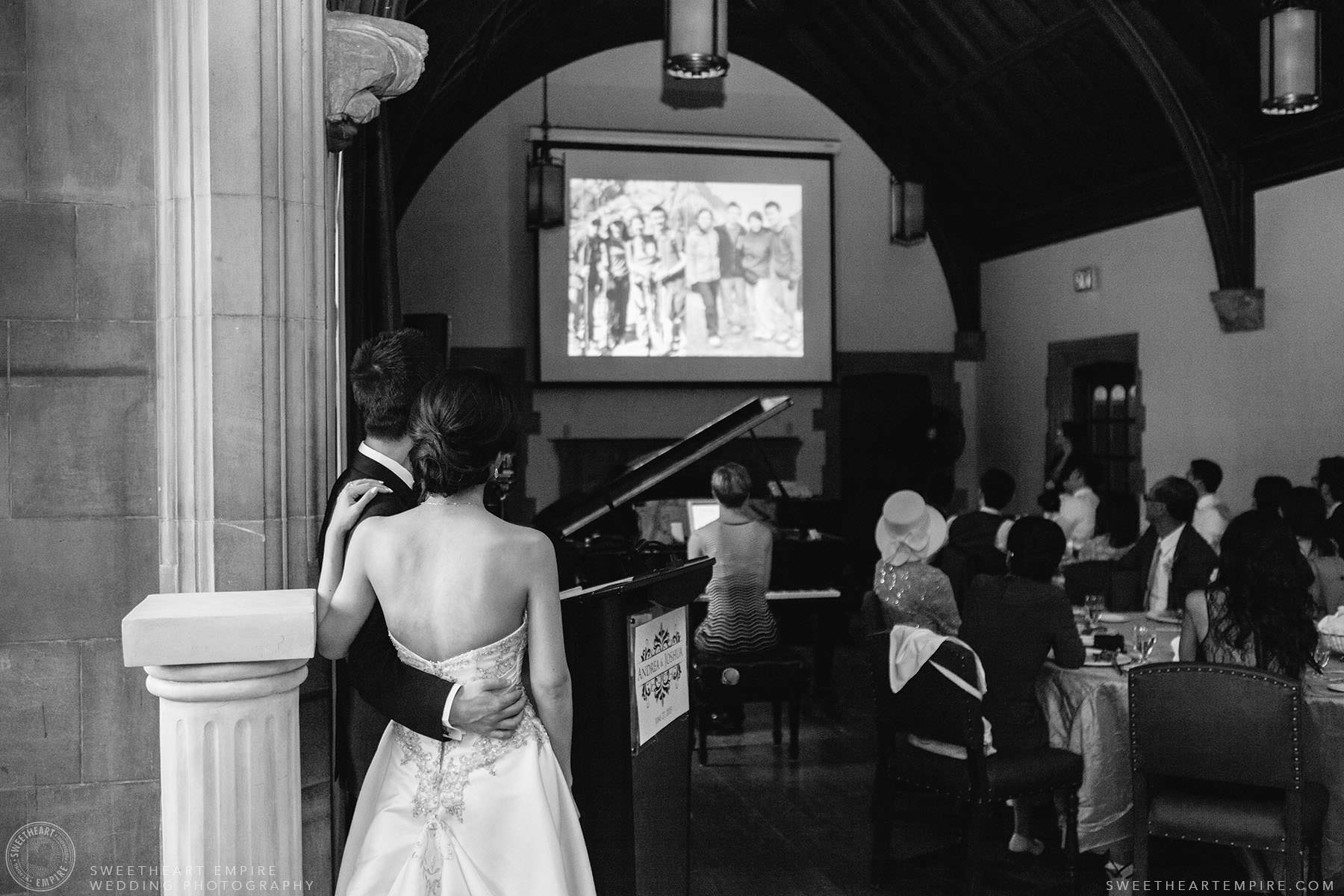 Bride and groom watching video with their guests during reception, Hart House University of Toronto Wedding