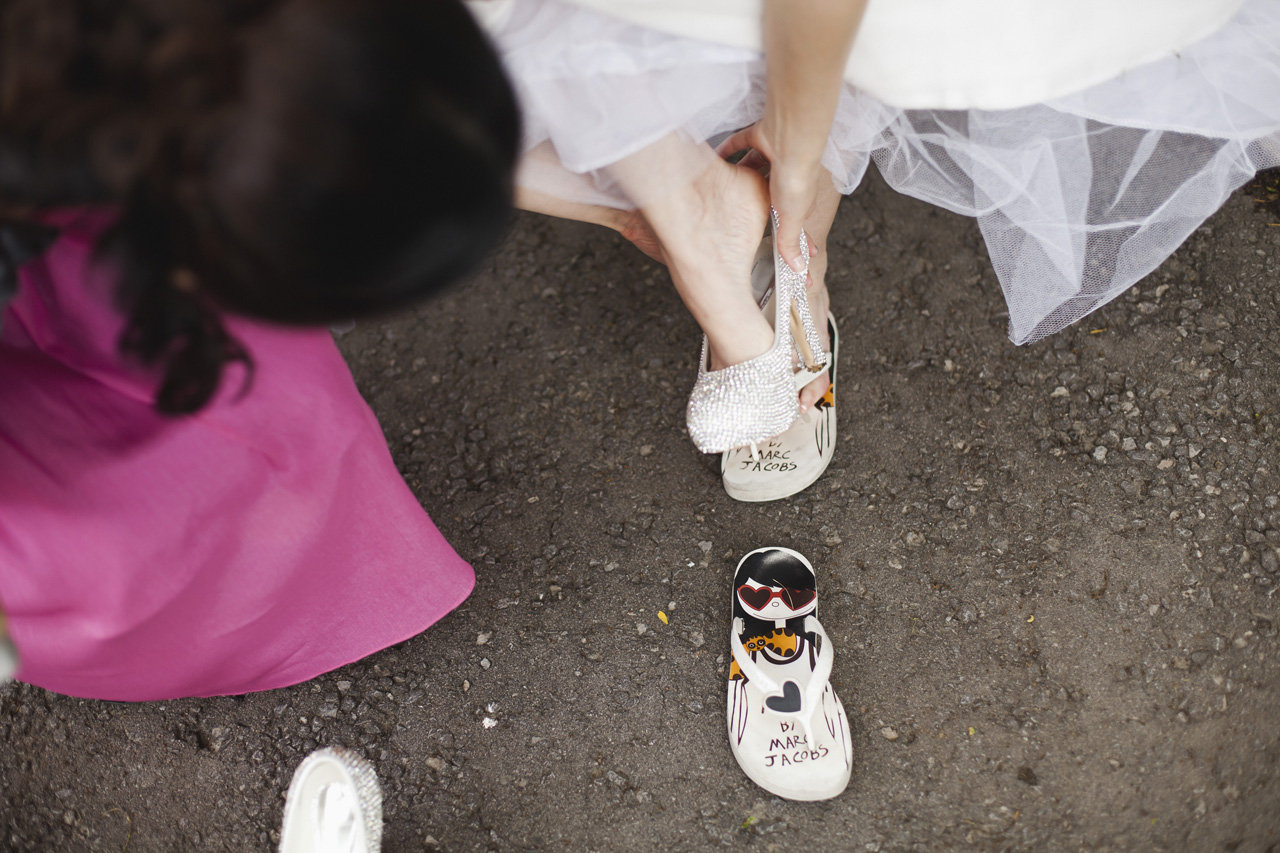Bride slipping into her Marc Jacob's flip flops, Bayview Golf & Country Club Wedding
