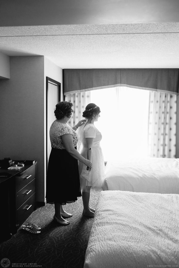Bride's mom helping her get ready; Aberfoyle Mill Wedding