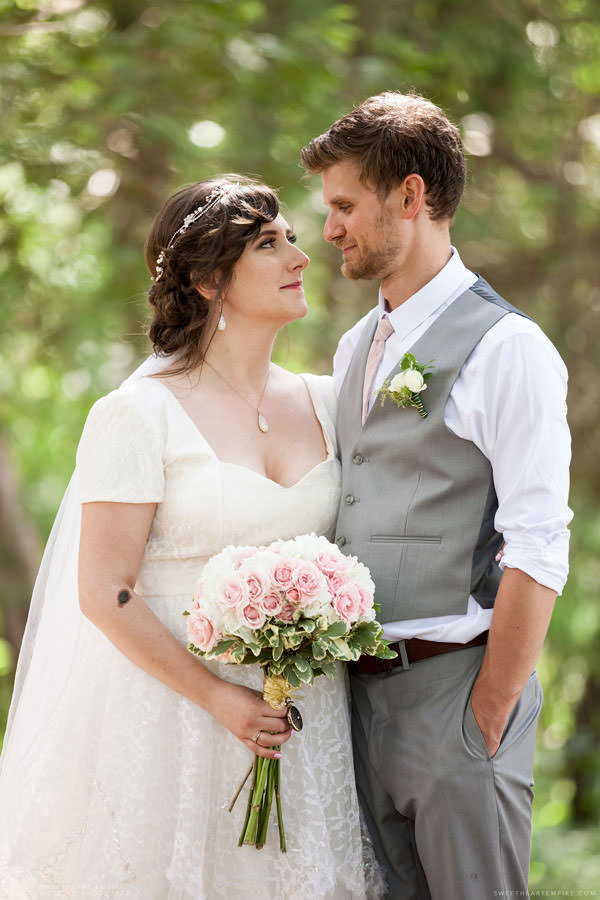 Bride and groom share a loving look; Aberfoyle Mill Wedding