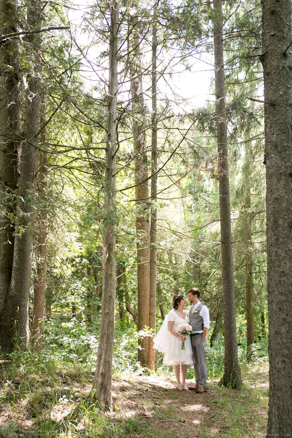 Bride and groom walking through the woods; Aberfoyle Mill Wedding