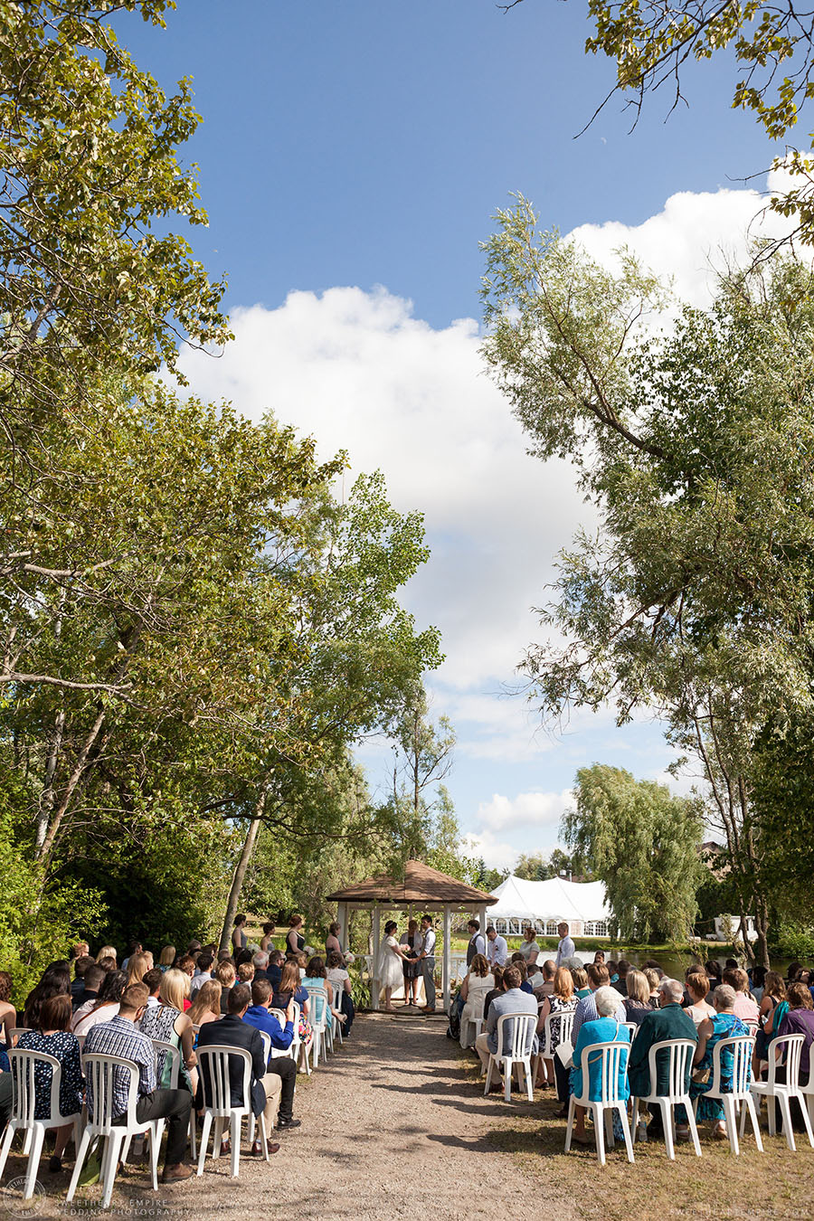 Bride and groom exchanging vows during outdoor ceremony; Aberfoyle Mill Wedding