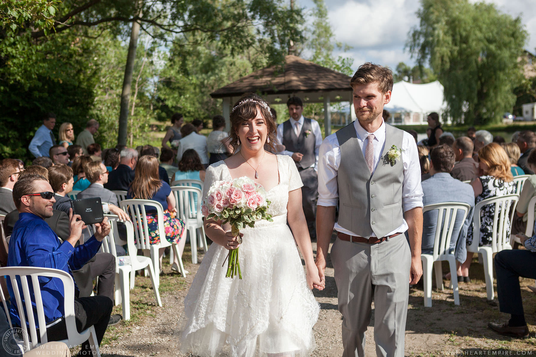 Bride and groom walking down the aisle after wedding ceremony; Aberfoyle Mill Wedding