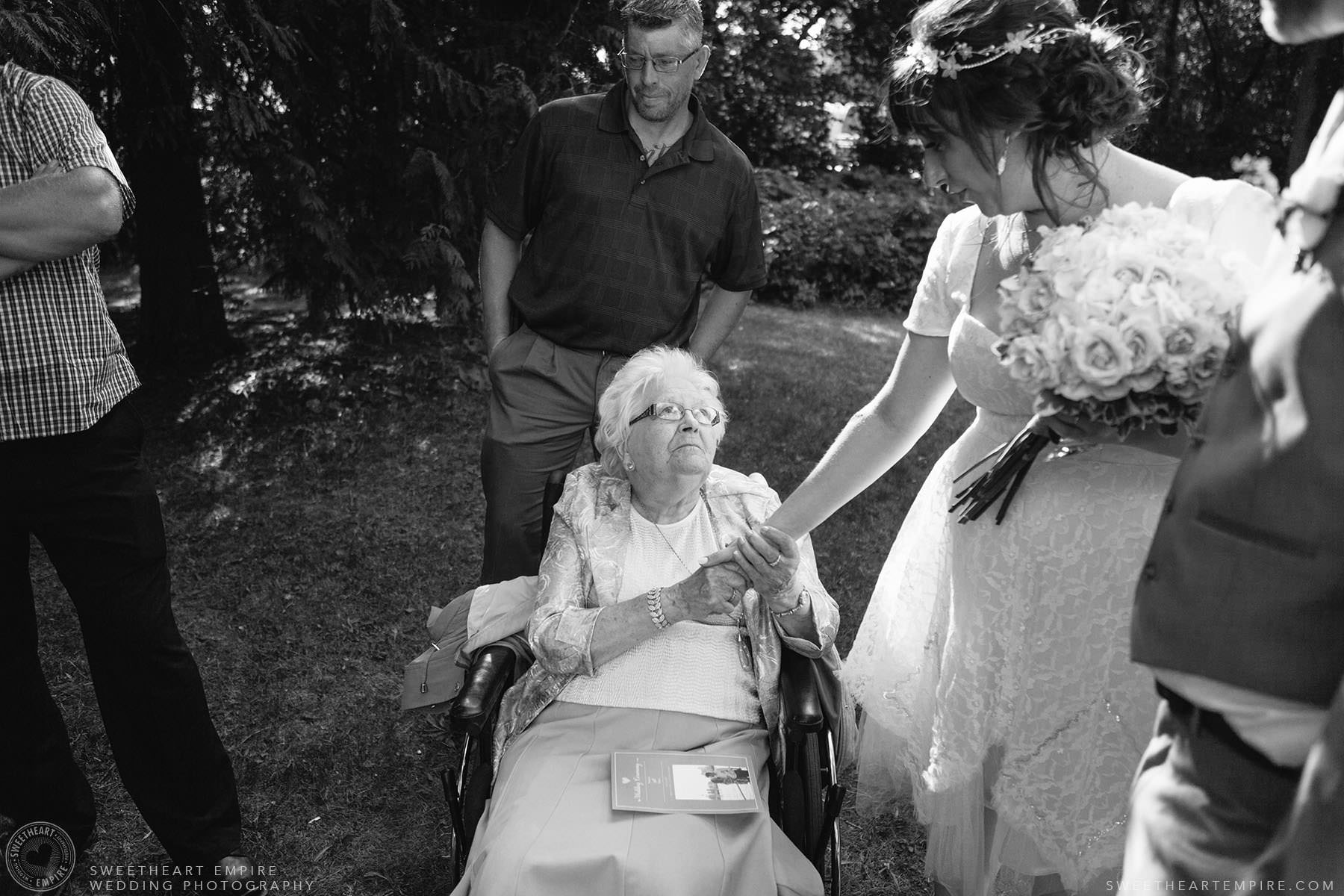 Bride greeting family members after the wedding ceremony; Aberfoyle Mill Wedding