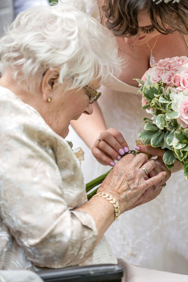 Bride showing the locket on her bouquet; Aberfoyle Mill Wedding