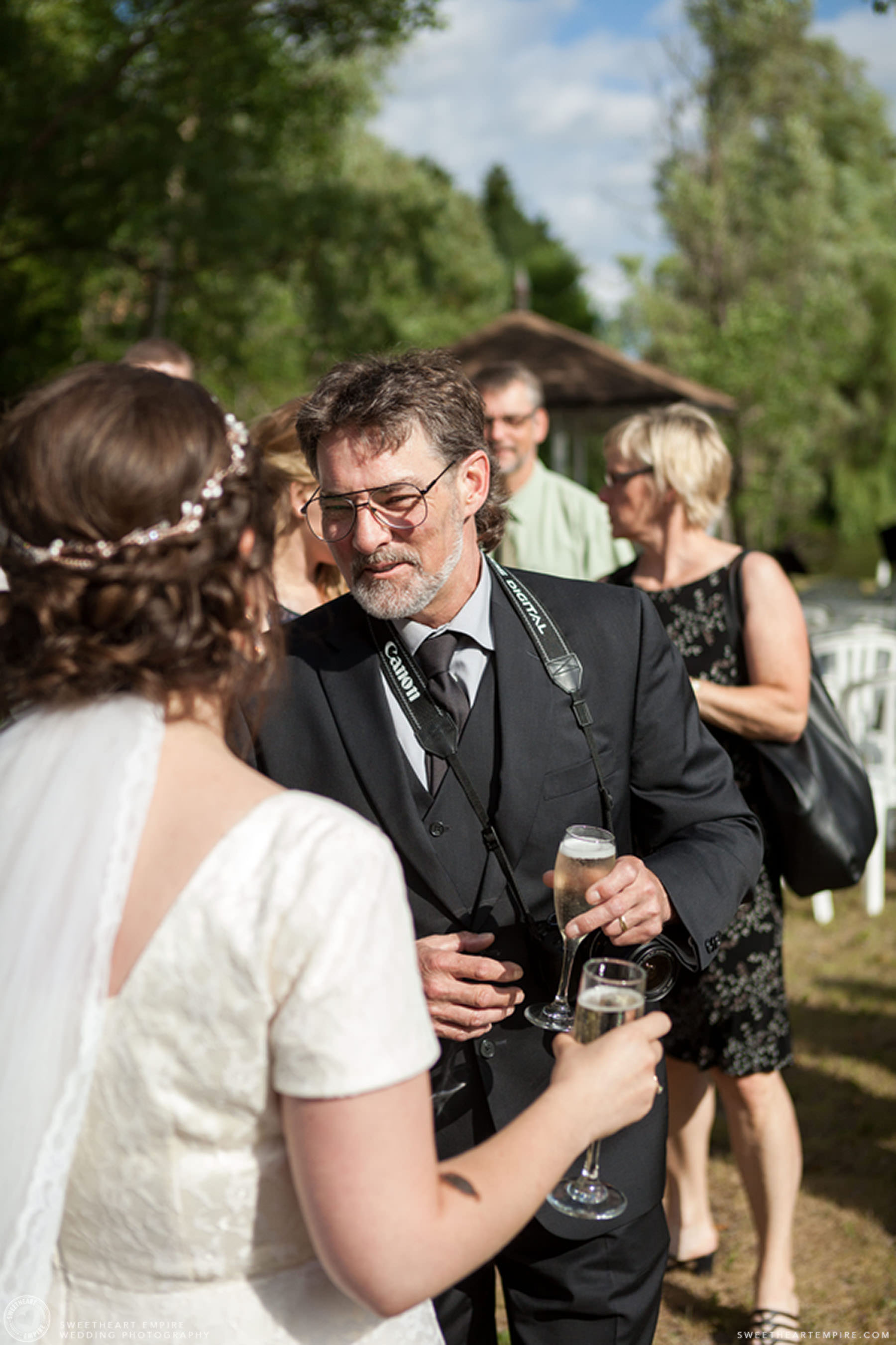 Bride having champagne with one of her guests; Aberfoyle Mill Wedding