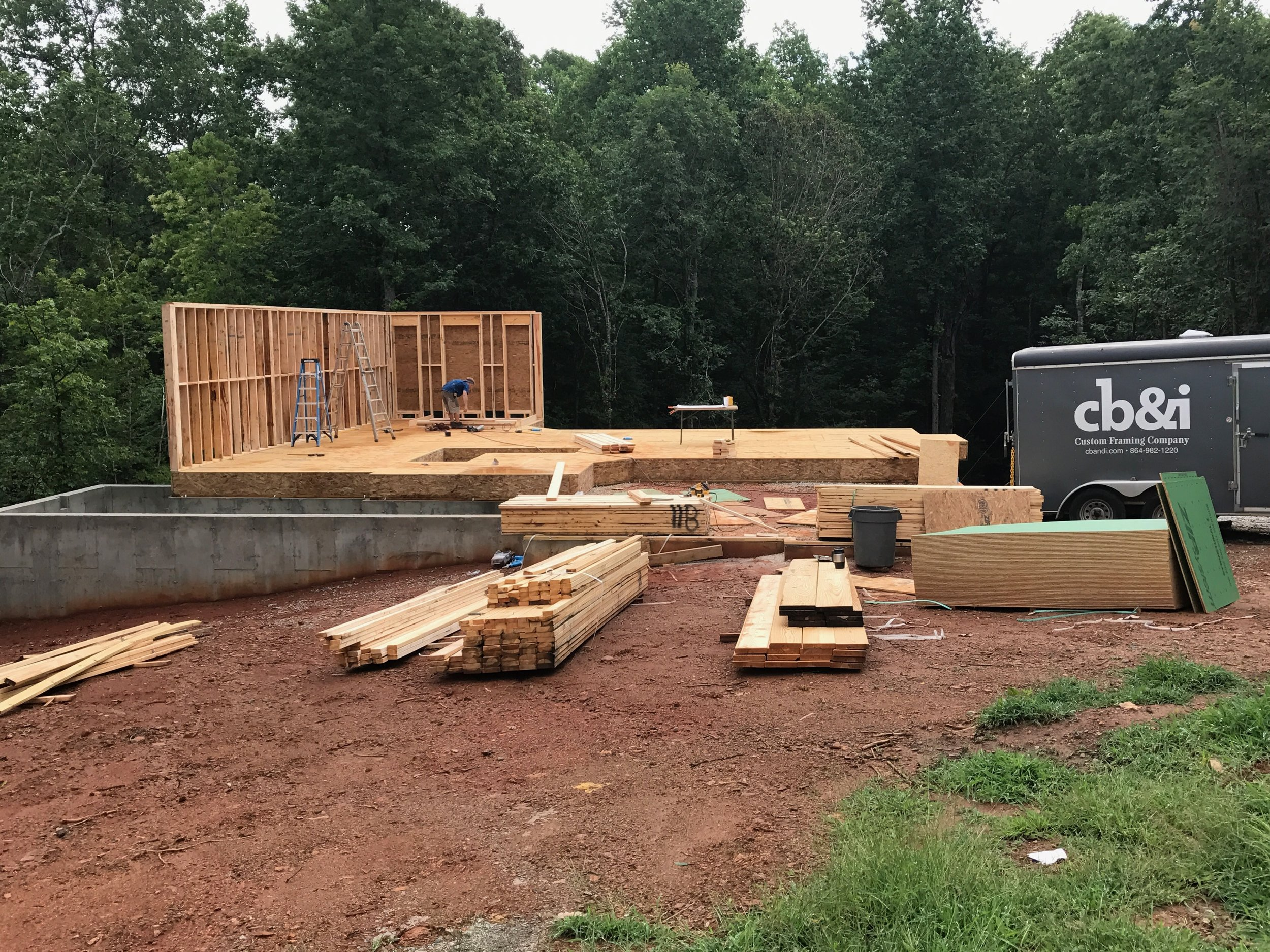Basement walls framed up with the 1st floor system installed and walls going up.