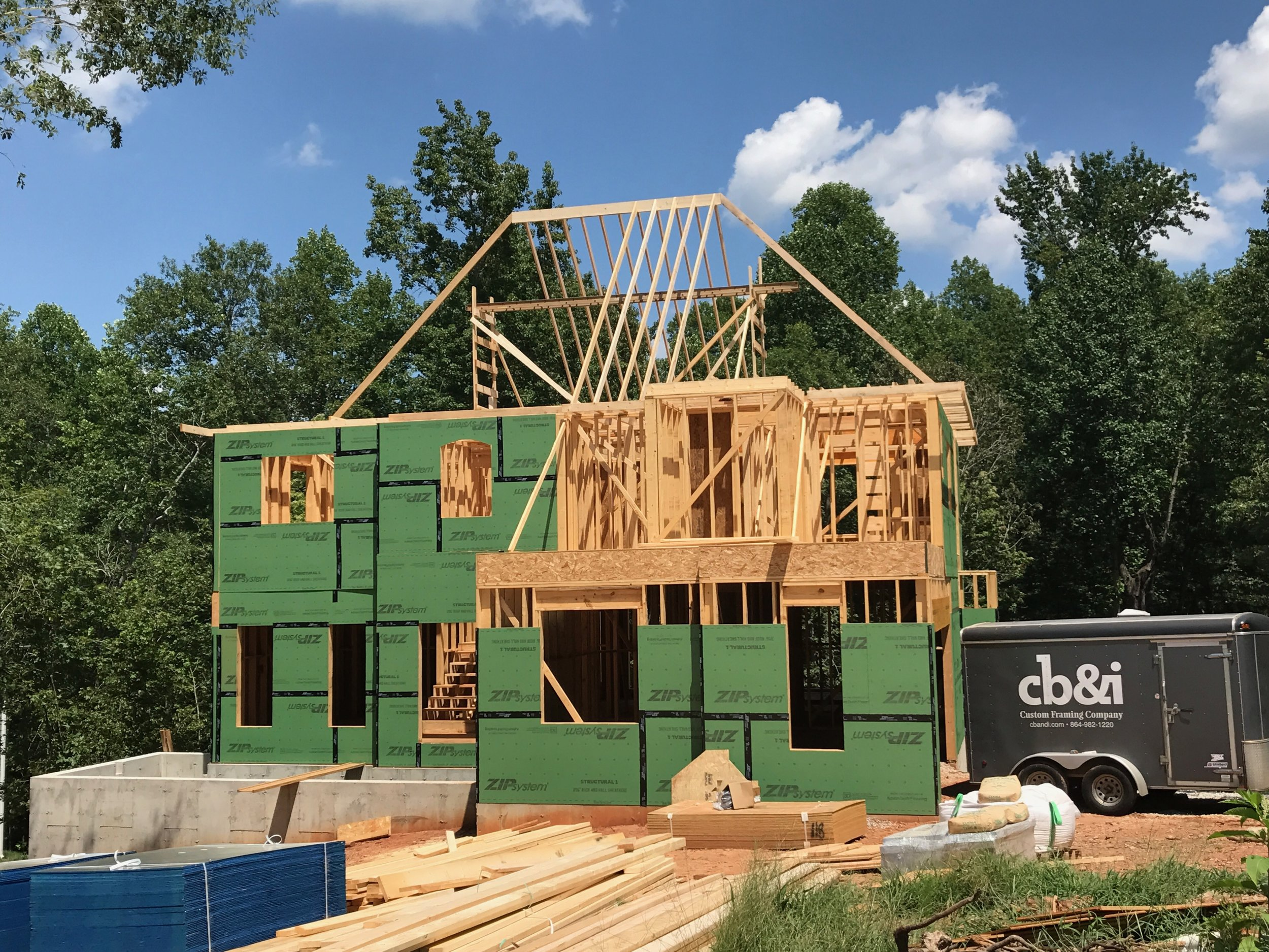 Second Floor walls complete, ceiling system installed, and the 1st ridge is up in the air!