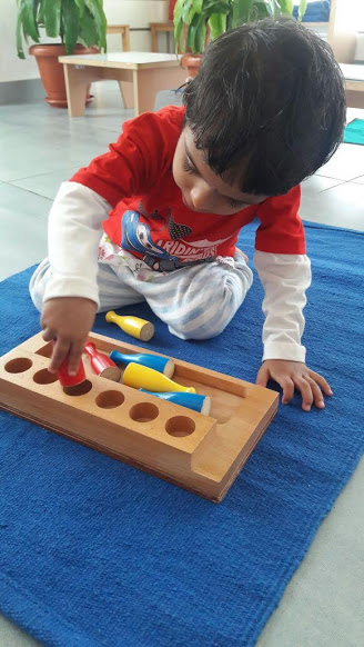 Working on introductory sensorial materials for toddlers