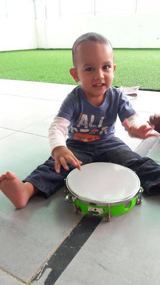 Enjoying the tambourine