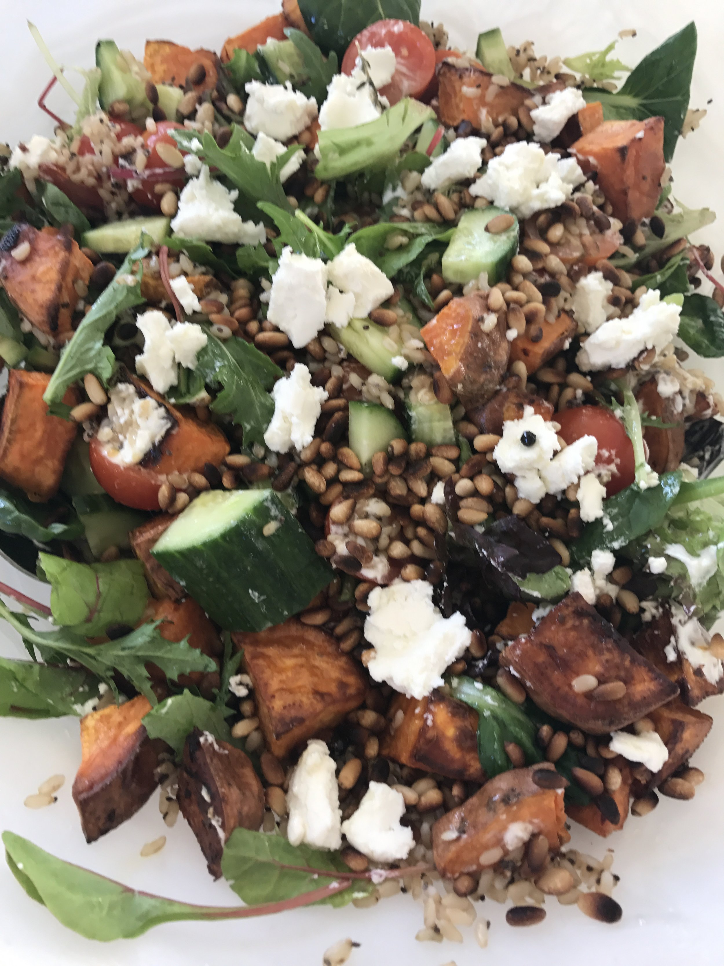 When you arrive home, remove sweet potato from oven and allow to cool. Toast the pine nuts and cook rice in microwave for 90 seconds. Chop tomatoes, toss ingredients into bowl and enjoy. I use a touch of the oil from the goats cheese as a dressing.