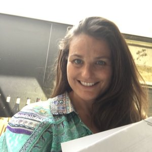 Kirsty signing the contract for The Midsummer Garden to be translated and published in German.