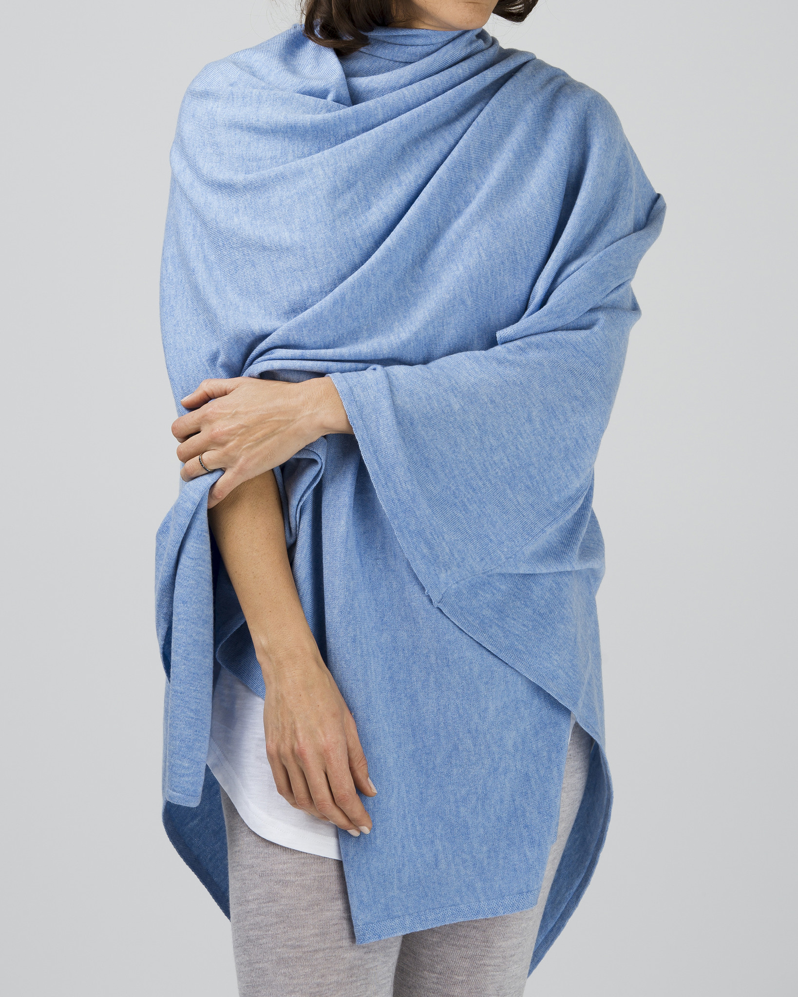 Merino 100% Oversized Wrap  $159.00  Available in 3 colours  100% supersoft washed merino. easily our most versatile piece. can work as a full-sized cape, wrapped around and styled, or as an oversized scarf. the ultimate travel companion.