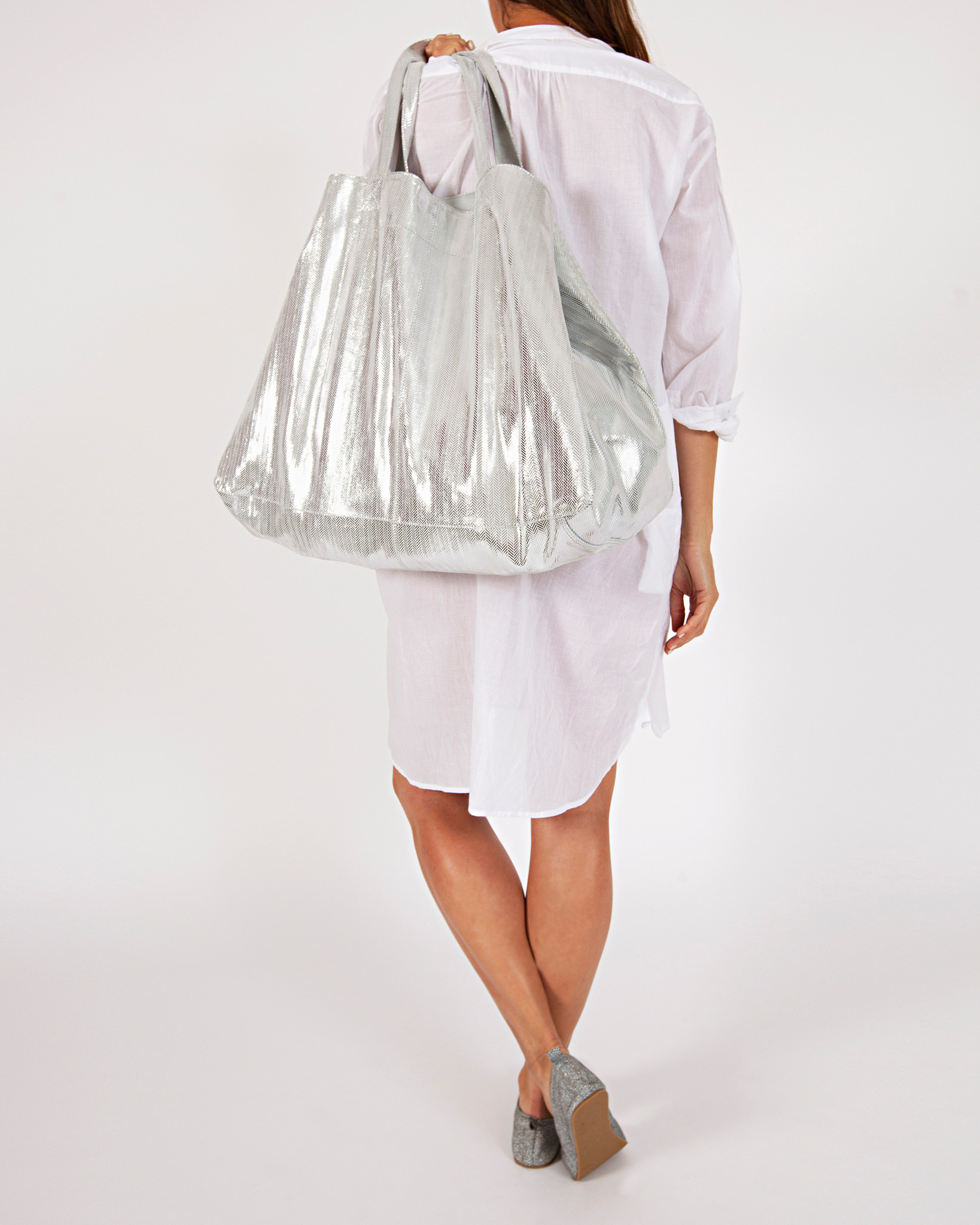 Leather Carry All Bag - Silver  $299.00  Available in 2 colours.  100% foiled cowhide leather unique herringbone metallic pattern soft, yet strong and durable leather includes inner pocket