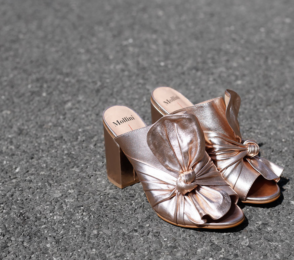 Millini  Openly Rose Gold Leather $189.95  Fabulous for warmer days, leading into winter. This shoe has been huge on the runways.