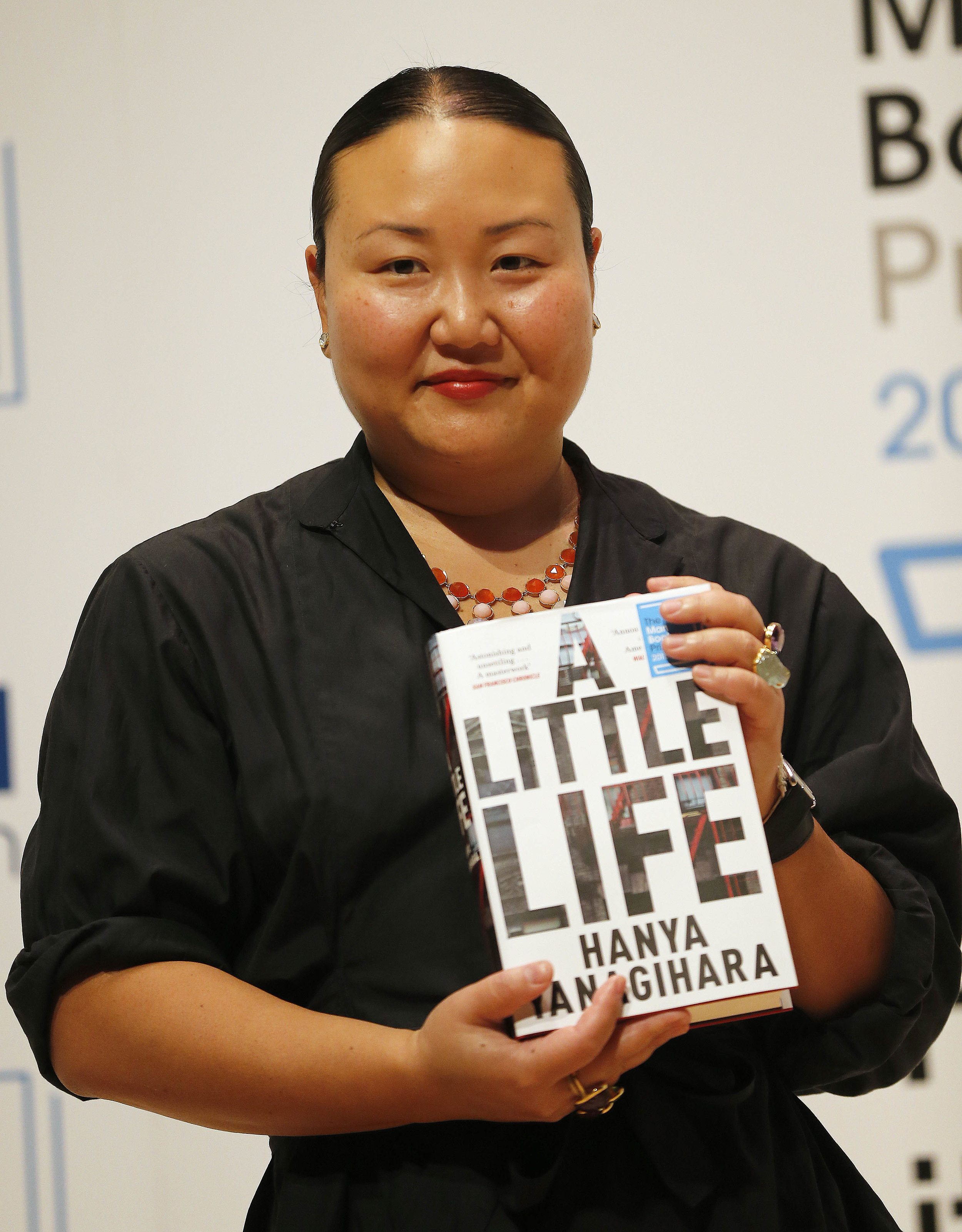 """Hana receiving one of her many awards for """"A Little Life"""".   Photo"""