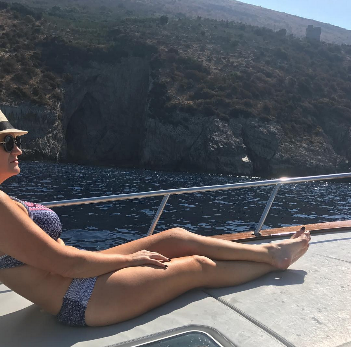 """In my own little world, on our private boat in the Amalfi Coast. I have finally learn't to celebrate my curves, which has taken me a long time to do.   Love these bikinis designed for """"luscious babes with curves"""" from  @sunseekeraustralia"""
