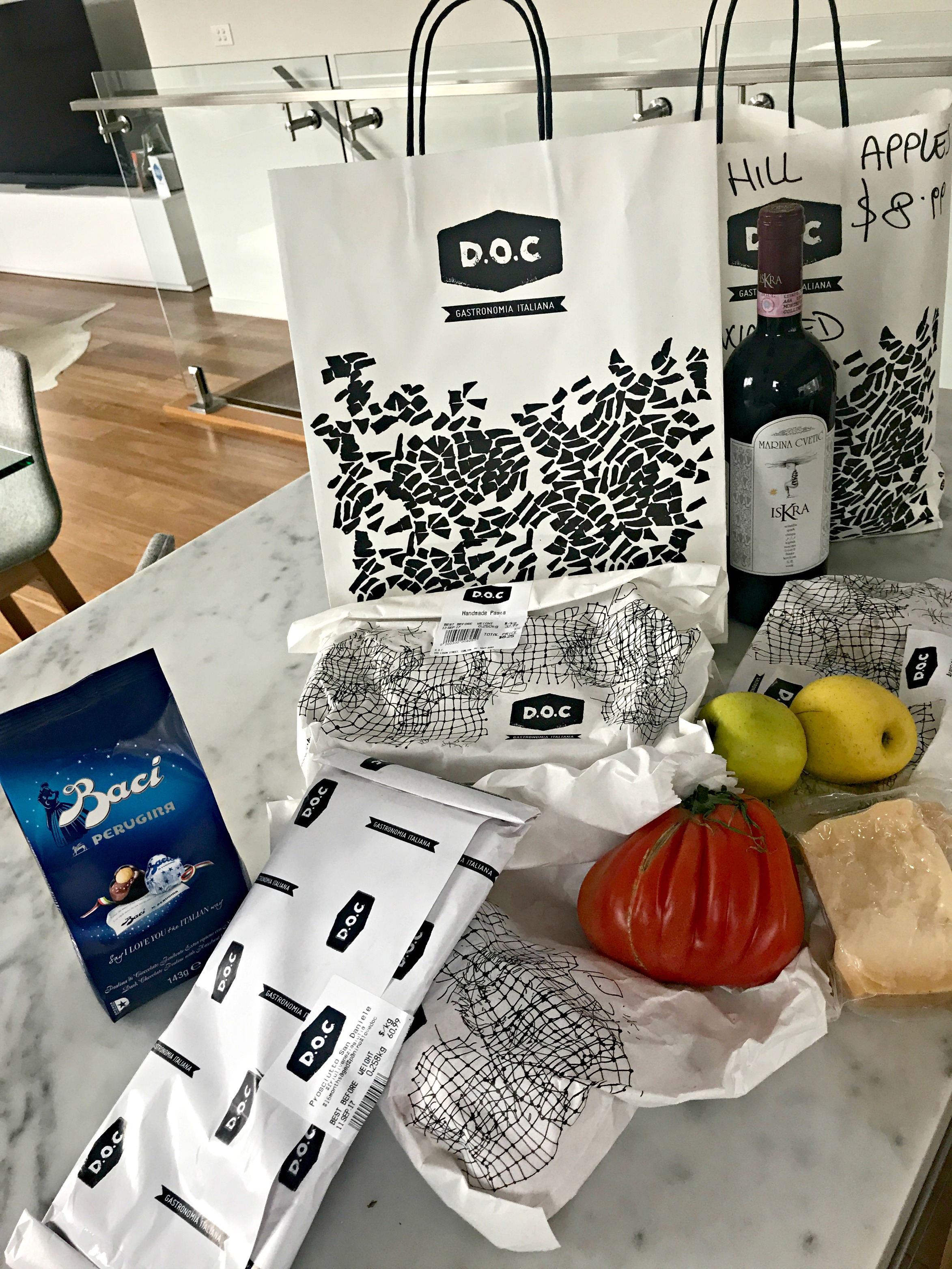 My purchases from D.O.C. Delicatessen. Organic apples and tomatoes, buffalo cheese, parmesan cheese, San Daniella prosciutto meat, home made spaghetti, Italian wine and my favourite Baci chocolates, (with little love notes).