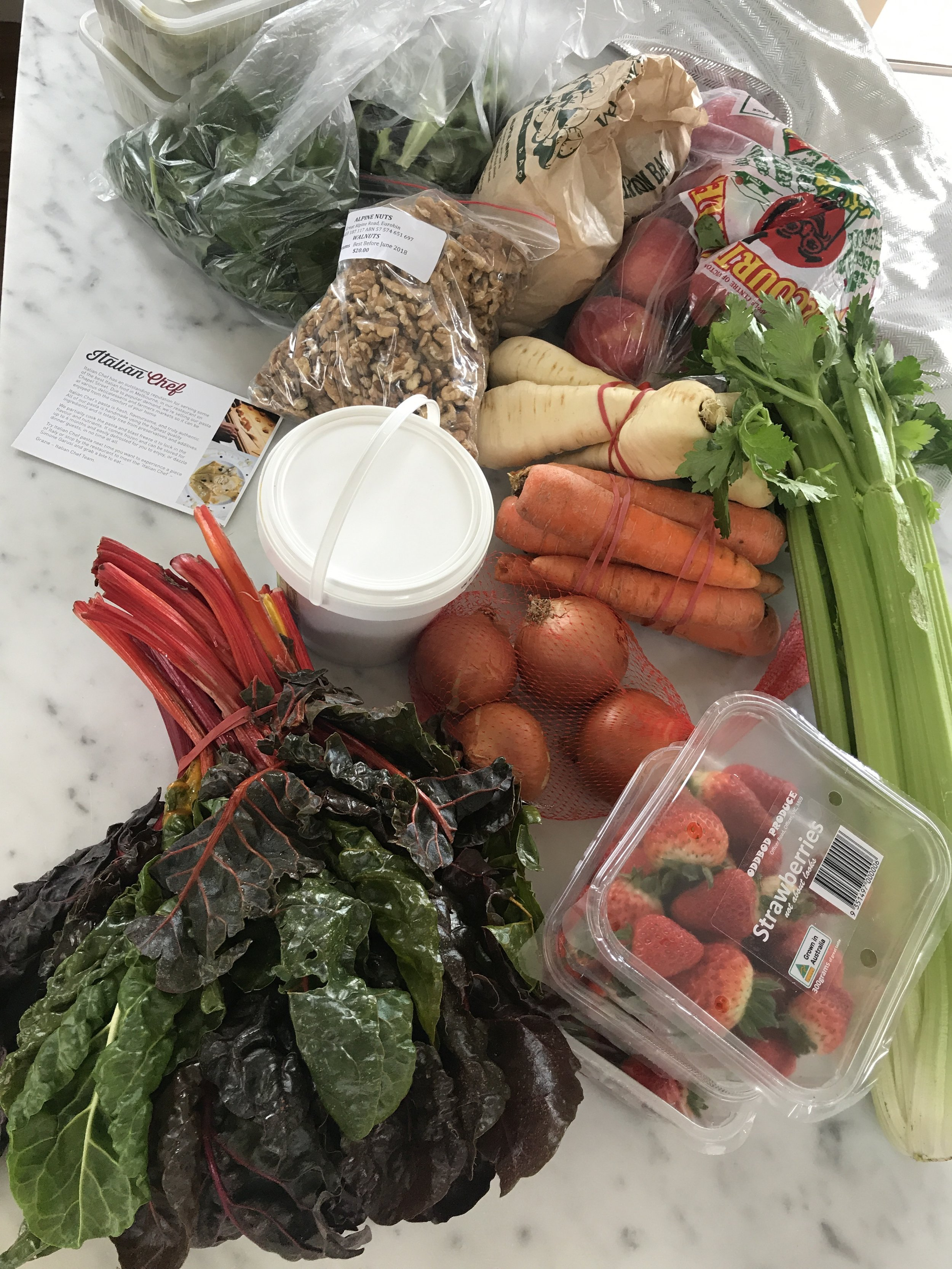 The produce purchased on this visit. Silverbeet, strawberries, onions, celery, organic yogurt, carrots, parsnip, walnuts, apples, mushrooms, spinach, lettuce, and home made ravioli pasta, which is in the freezer,and a recipe card from my gorgeous Italian pasta man.