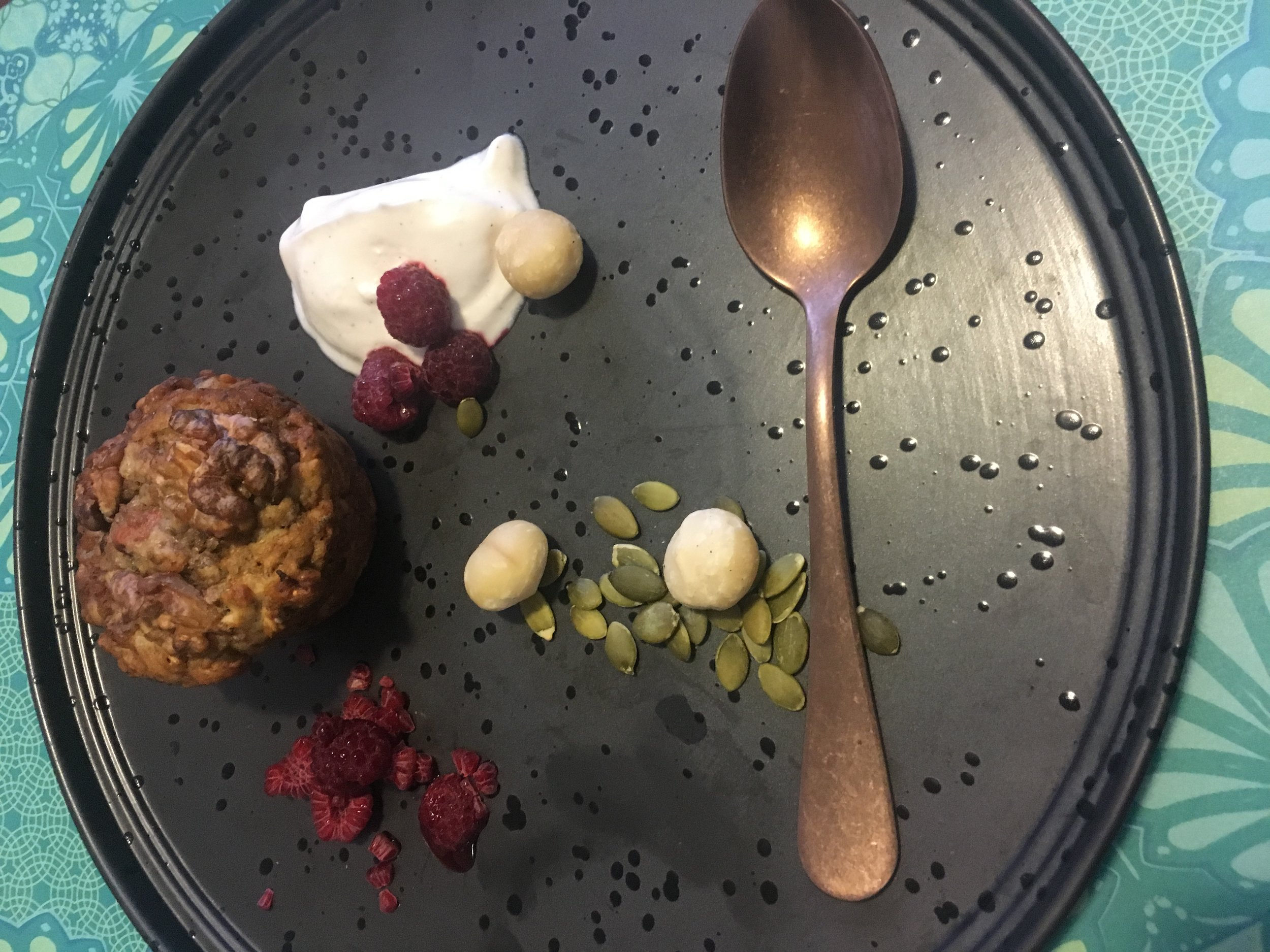 """I gave a muffin to our """"foodie"""" Suzanne, who styled it with yogurt, raspberries, macadamia nuts, and pumpkin seeds for her lunch."""