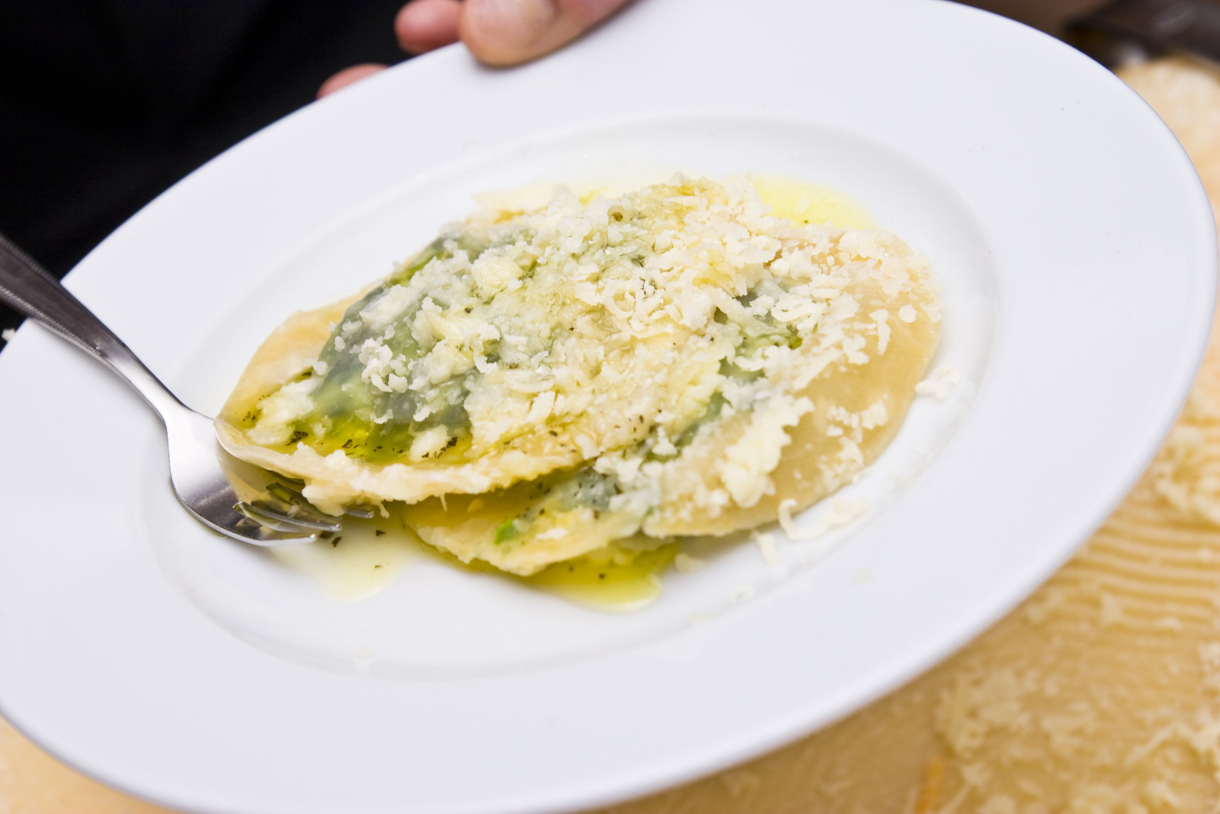 We don't smother the pasta in thick sauce now.  Simplicity is the key.  Home made ravioli from the market, with a sage and butter sauce.  Sprinkled with parmesan cheese.