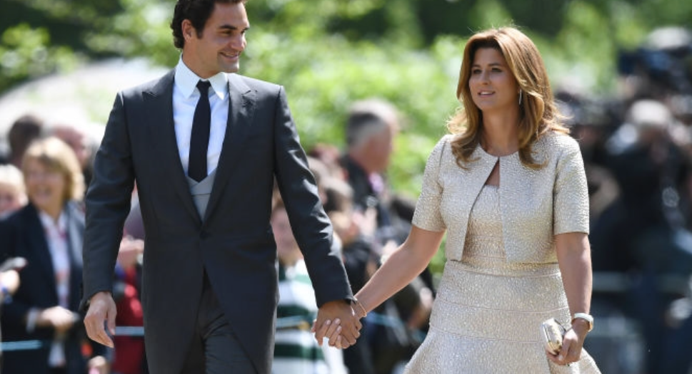 What a team! Swiss tennis player  Roger Federer (L) and his wife Mirka attend the wedding of  Pippa Middleton and  James Matthews at St Mark's Church on May 20, 2017 in Englefield Green, England.