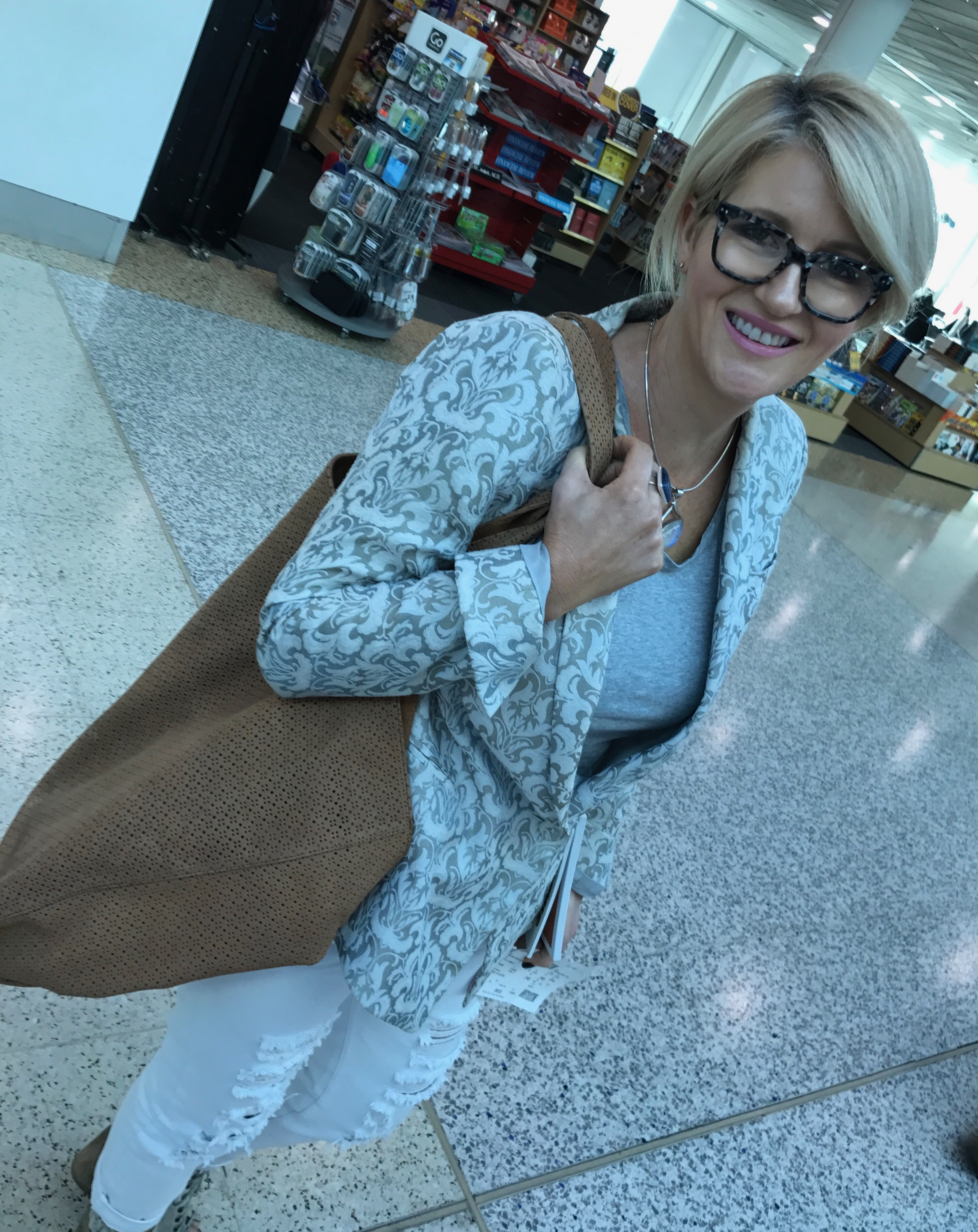 """At the airport last year with my """"couch"""" blazer. The kids think it looks like a couch cover, but this Carla Zampatti jacket has been my travel companion for years. A great investment that I can scrunch up in a bag and it still looks great. The couch is here to stay!"""