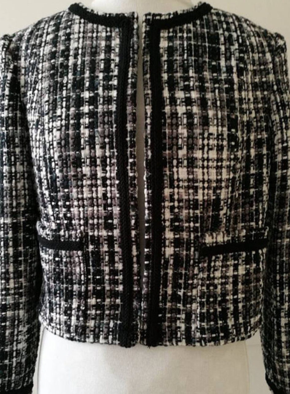There is a variety of Chanel's tweed coats available at  Etsy.
