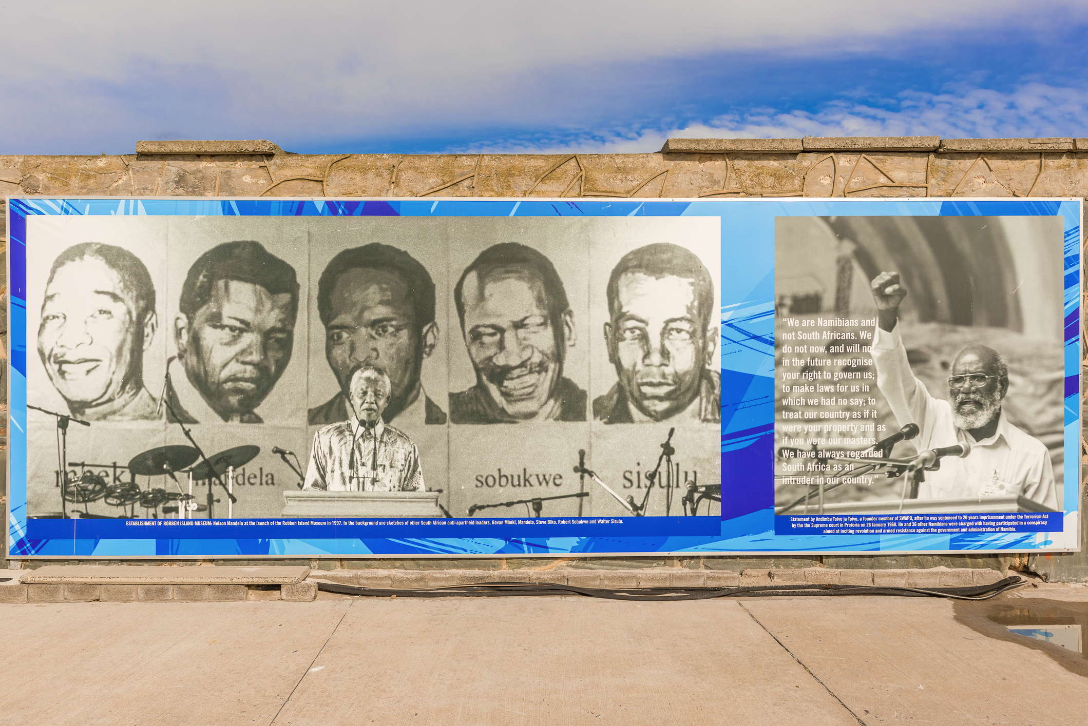 Cape Town, South Africa - May 14, 2015: Banner on Robben Island Prison wall where Nelson Mandela was imprisoned, now a museum, Cape Town, South Africa.