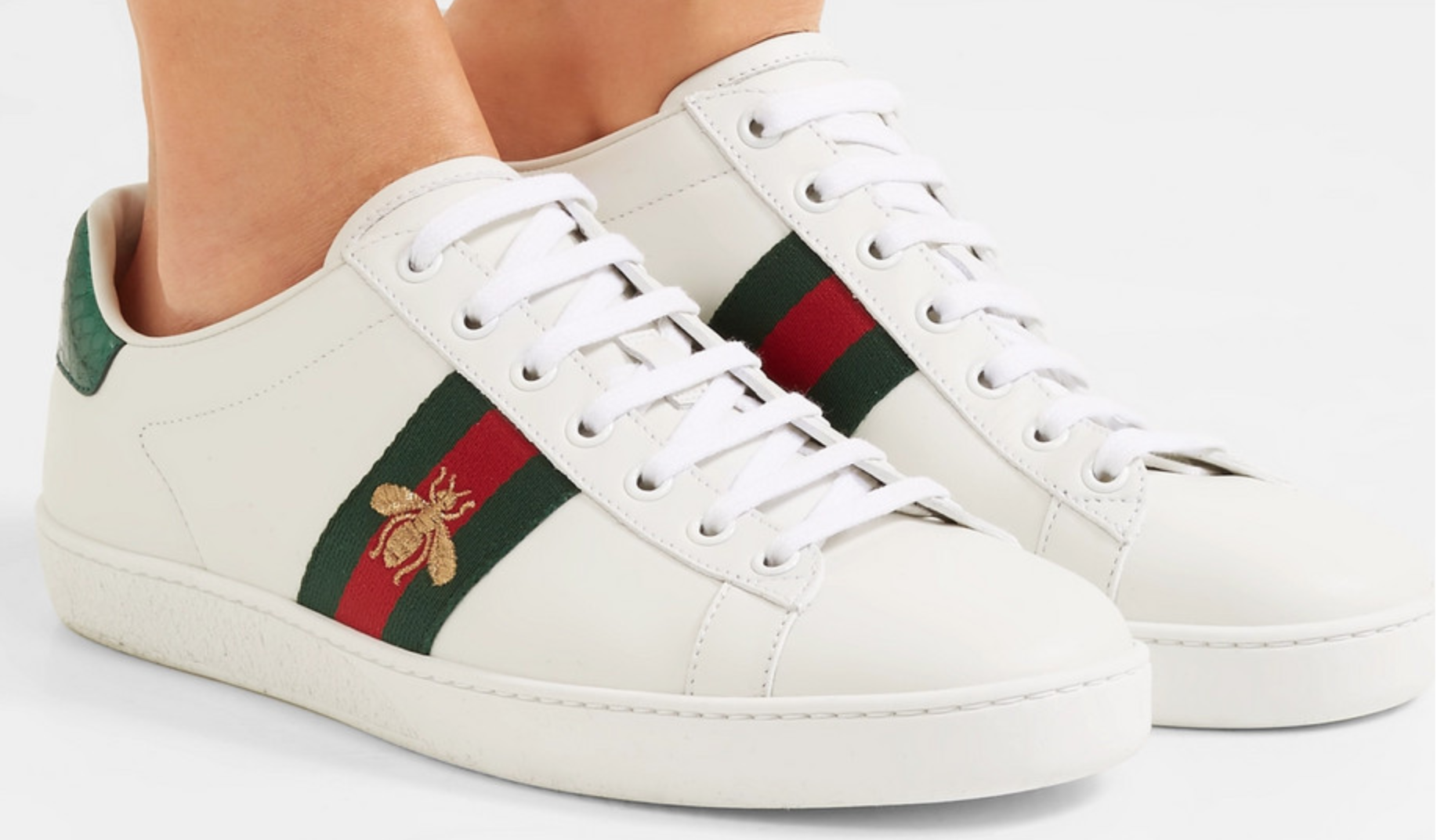 The popular Gucci Ace watersnake-trimmed embroidered leather sneakers.  $790 from  net-a-porter.com.