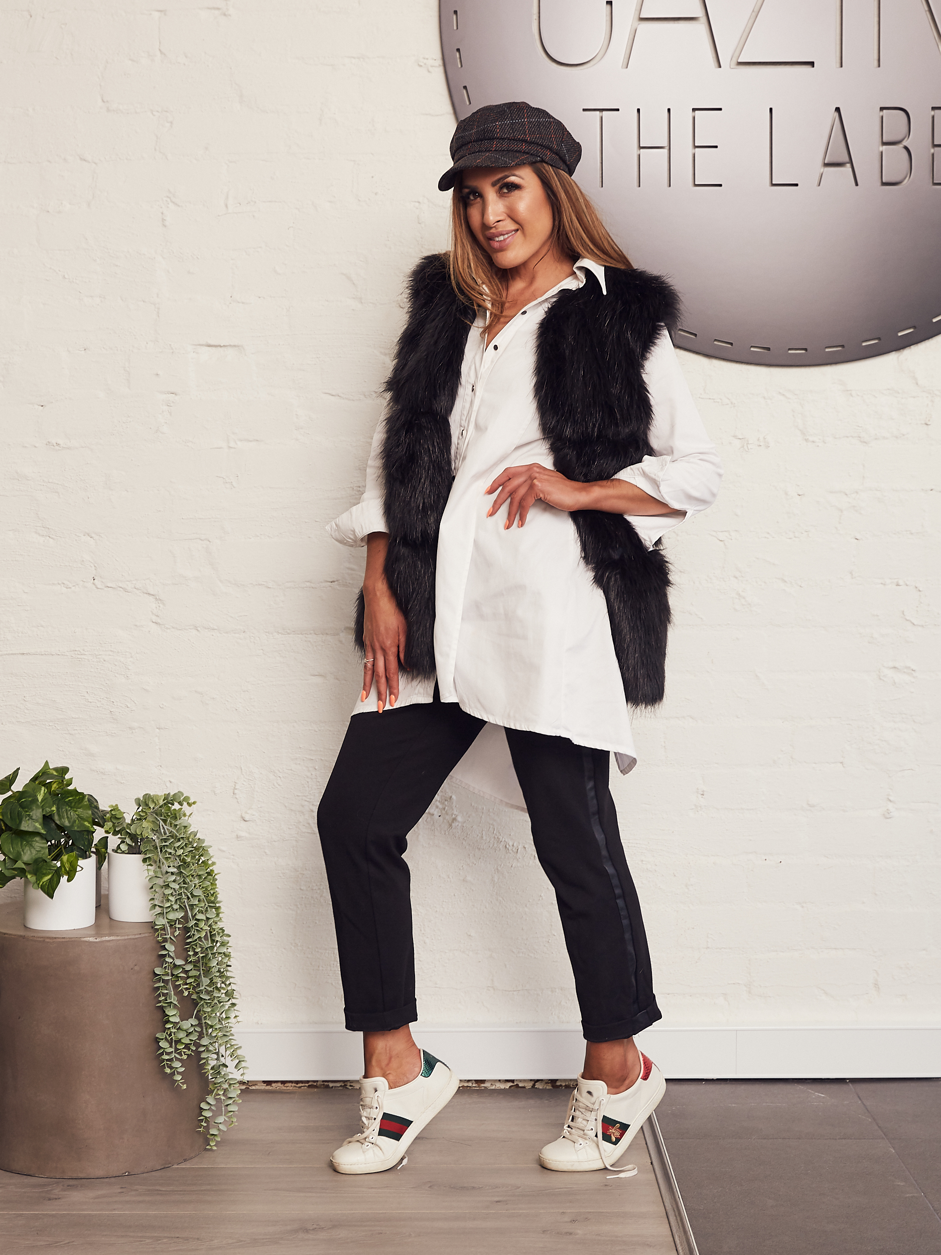 Take your style to casual with runners, hat and a faux fur vest.
