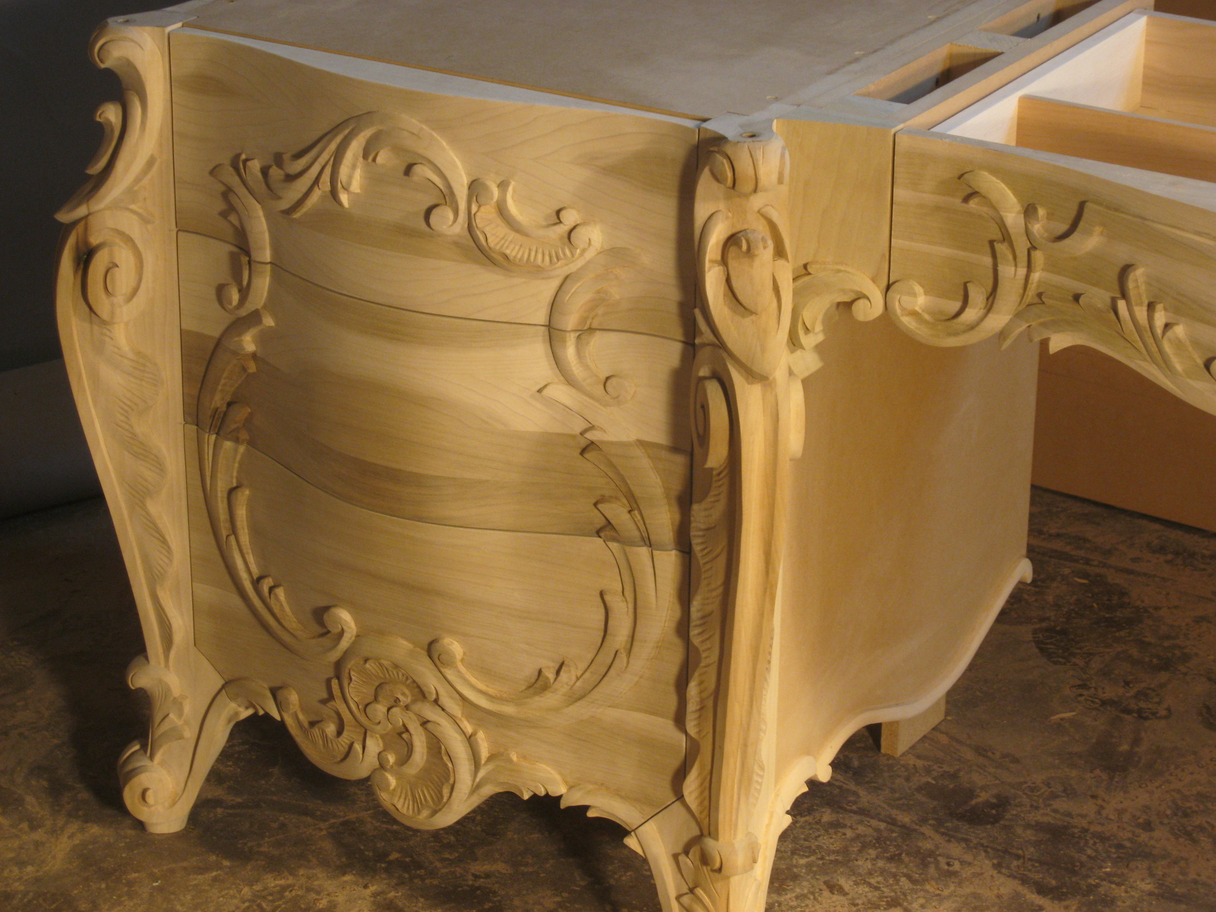 custom carved wood vanity.