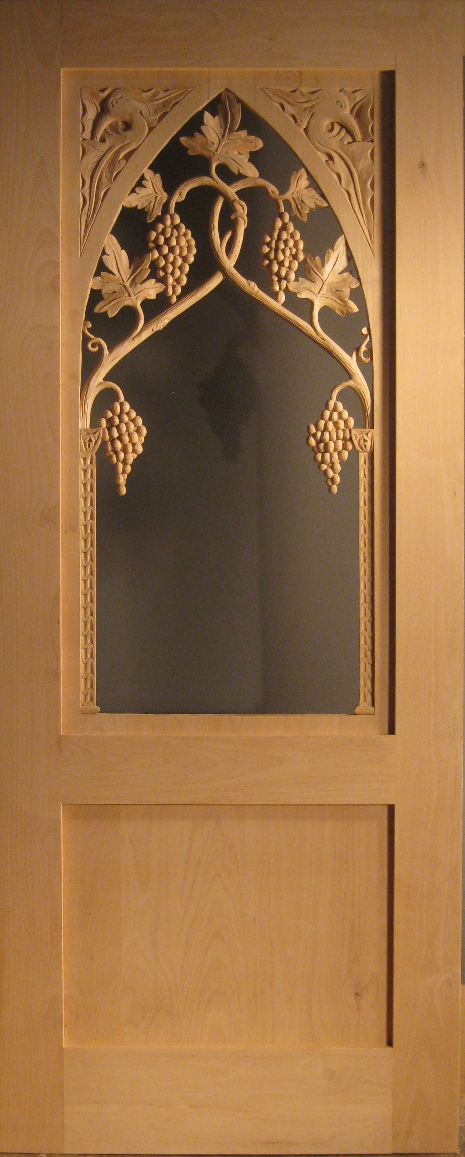 Abby, carved wood and glass wine cellar door