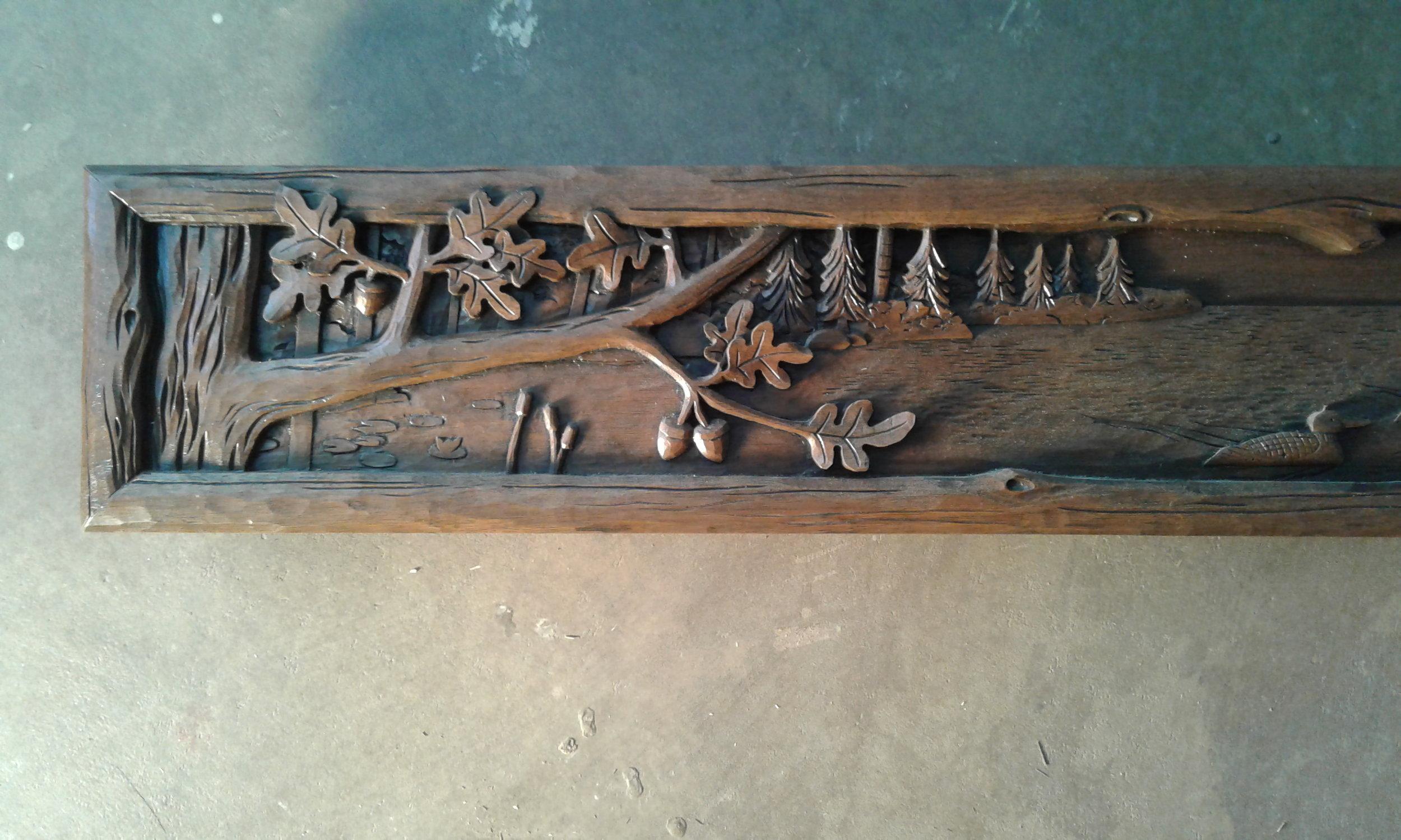 rustic carved mantel, left.