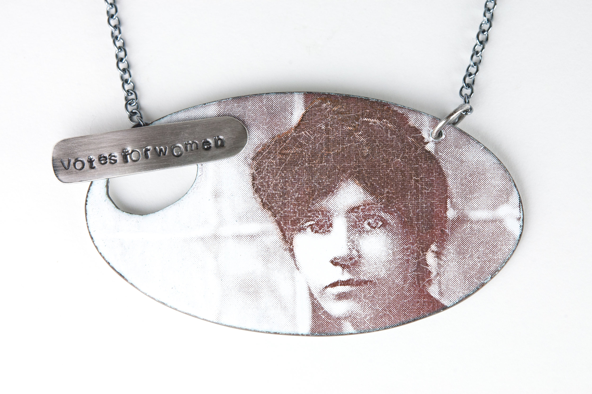 Alice Paul - enameled copper pendant with photographic image decal (courtesy of The Library of Congress) and sterling silver findings.