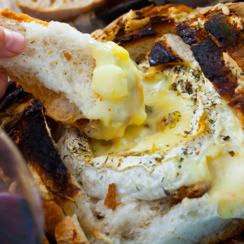 cheesy fondu soup in bread dipped