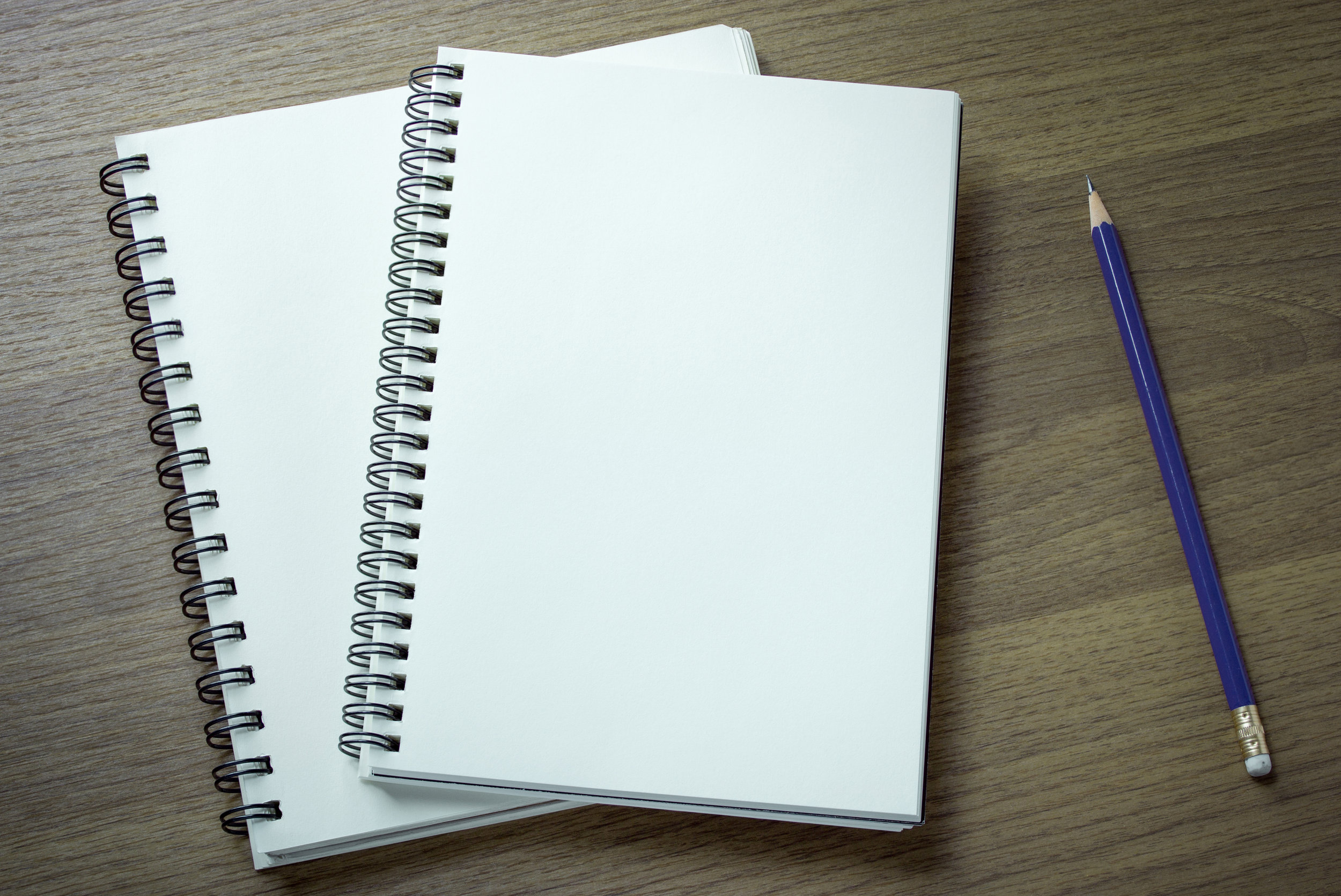 Notebook on Wood Background.jpg
