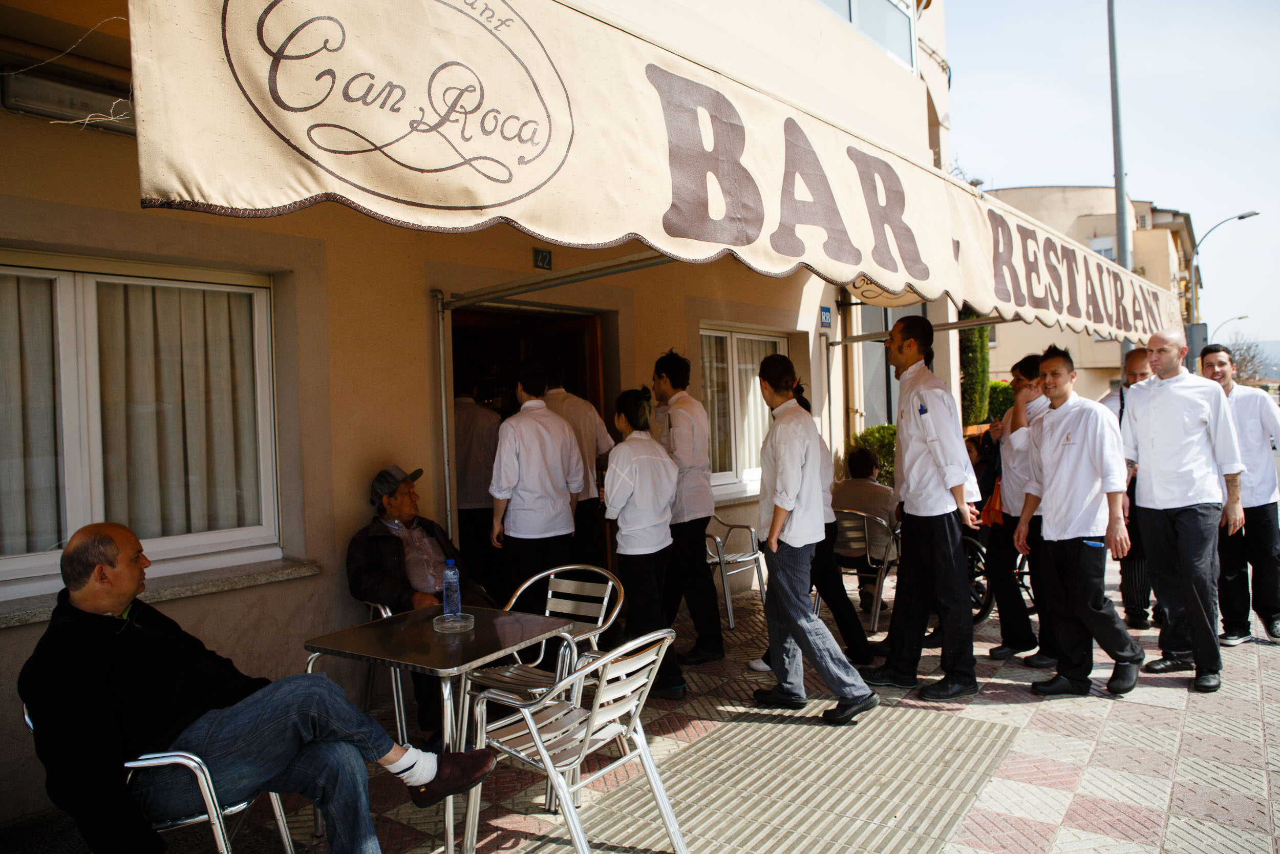 14/3/14 Brothers Joan (white coat) and Josep (blue jacket) lead El Cellar de Can Roca staff to their parents' restaurant for lunch, Girona, Spain. Photo by James Sturcke | www.sturcke.org