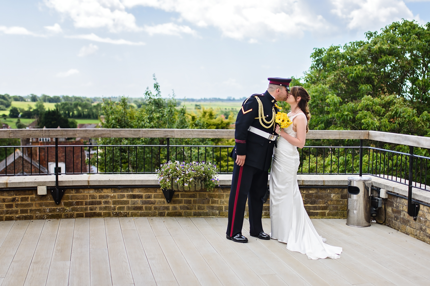 Bride and groom celebrating after ceremony | roof terrace | Arundel Town Hall